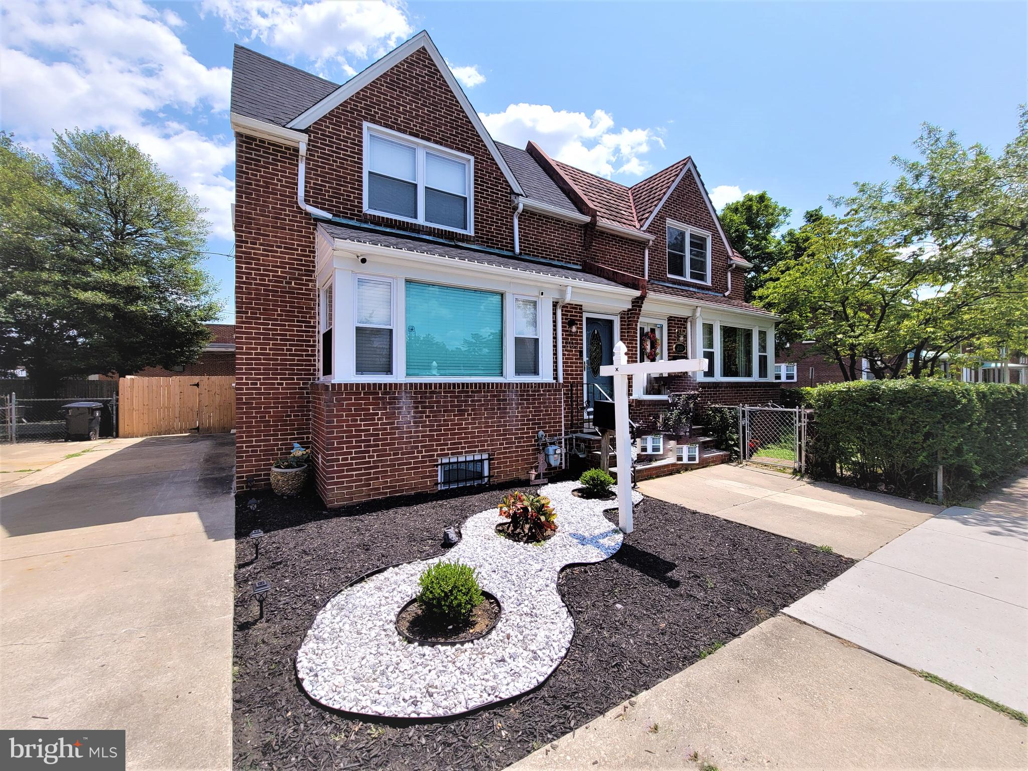Gorgeous Bancroft Parkway brick twin.  This semi-detached charmer was throughly renovated in 2019 and has been lovingly maintained ever since.  Featuring 3 bedrooms, a full bath and two (2) half baths with a fantastic open floor plan and tons of updates.  The 2019 renovation included new roof, new windows, new HVAC, gourmet kitchen with granite tops and stainless steel appliances, recessed lighting, ceiling  new flooring throughout, custom paint and trim and so much more. Large finished area in the basement with 1/2 bath, tons of additional storage and an outside entrance.  Off the kitchen is an enlosed porch leading to the newly fenced in back yard.  Nice long driveway and off street parking as well. This home shows like a model and sits right on beautiful Bancroft Parkway.  Put it on your tour today!