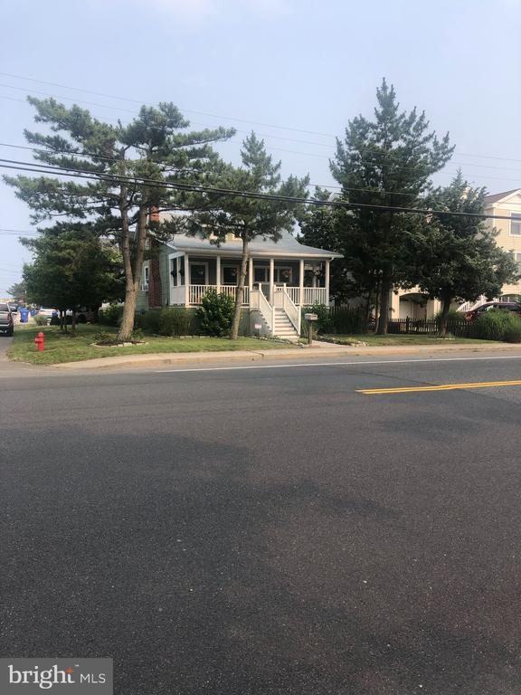 """Looking to live Oceanside in prestigious Little Egg Harbor Yacht Club area?  This charming beach cottage sits on a 50 X 100 lot.  The inviting back yard, features a garden of flowers and herbs.  Also has a detached garage.  Another option would be to build your dream home here ... Choices are endless.  Being sold """"AS-IS"""" --- Seller will provide the re-sale CO."""
