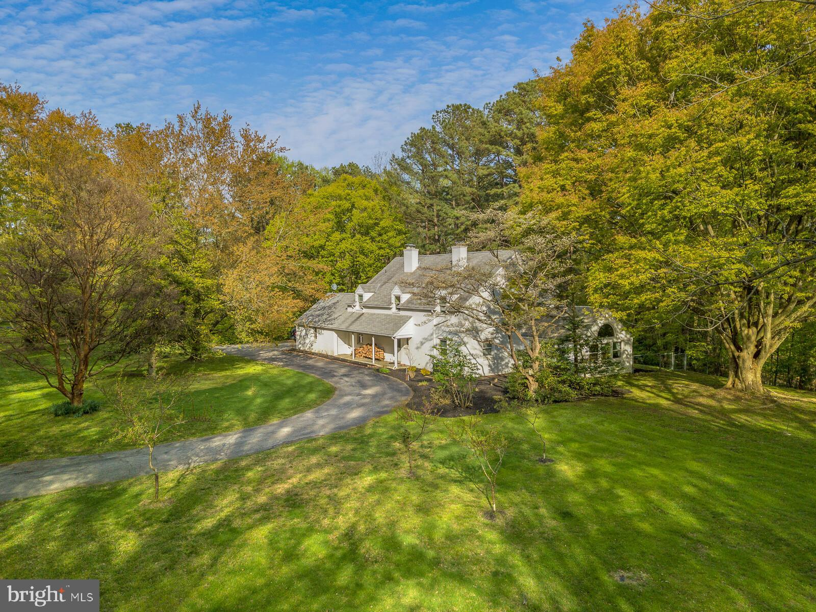 Welcome to 597 Horseshoe Hill Road. This traditional home is situated on an astonishing  10 acres of green hills. There is a walking trail that circles the home, offering a quiet retreat and bucolic views. Part of owning in this neighborhood, means access to the tennis court and even a pond that you may fish in! The pond is a short walk from the house, along the private road. Step inside. This home has a huge living room, perfect for entertaining, replete with hardwood floors that extend through the whole house. The kitchen is has been furnished with granite counter tops and crown molding around the newer cabinets. Recessed lighting has also been installed, highlighting the undermounted sink, textured backsplash, chefs stove and low profile microwave. The windows in the home are top of the line Andersen. Make your way upstairs and you will find three large bedrooms, and two full baths. All bedrooms also have hardwood floors. There is an additional bedroom on the first floor, that is currently used as a study. The full basement offers high ceilings, perfect for finishing, and even a sauna. This unique and charming home is ready for its new owners.