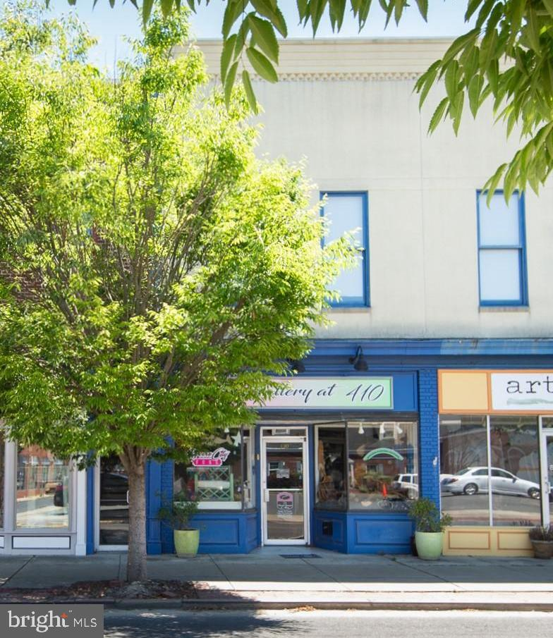Great commercial space in downtown Cambridge.   Two second floor condos - total  of 1700 sq. ft +/- currently used as 4 artist/retail lofts. Two baths .
