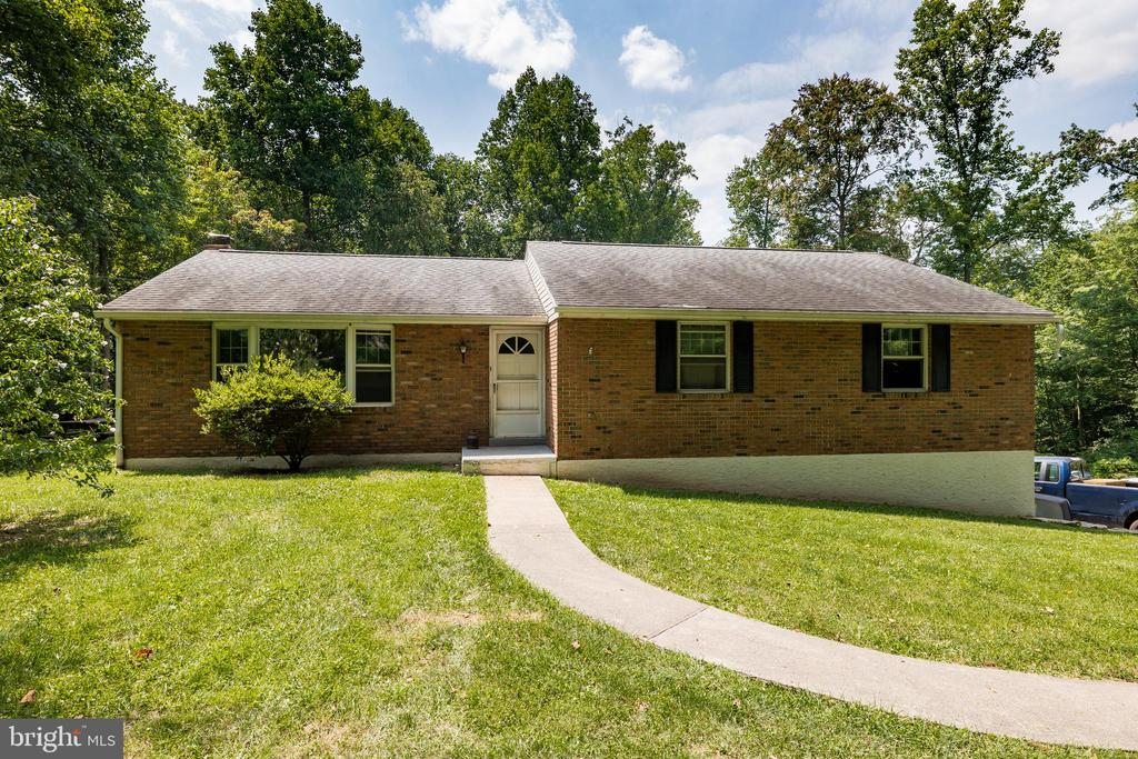 Welcome Home to this 3 Bedroom Brick Ranch home located on a total of 12.6 acres of spectacular land in North Coventry Township.  Home features 3 bedrooms and 2 full bathrooms, oversized 2 car garage, finished basement, back porch, etc - all just waiting for you to bring your updating talents!     Home is located on Tax ID 17-02-0012.  Additional lots:  17-02-0011.0100 and 17-02-0010 Act 319 tax treatment.  Possibilities are endless for someone looking for a secluded lot with privacy - or for potential subdivision as the land is already listed as 3 separate parcels.  Home is located on 4.5 acres, second parcel is 5.4 acres and third parcel is 2.7 acres.  And all of this is located in DESIRABLE OWEN J ROBERTS SCHOOL DISTRICT.  This is the OPPORTUNITY you have been waiting for!!
