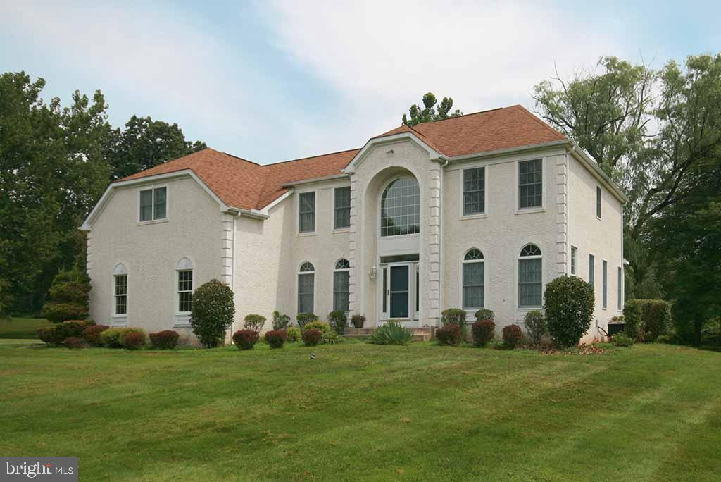 This French Petite Chateaux is situated on over 2 acres at the end of a cul de sac in a beautiful setting bordering woods and dedicated open space with a little stream. The spacious home features a gracious two- story foyer with marble floor, a Living Room, Study/Library, Formal Dining Room with butler's pantry to a large kitchen with an island, granite countertops, stainless steel appliances and a breakfast area open to the vaulted ceiling family room. The family room is highlighted by a fireplace with marble surround and a Palladian window overlooking the lovely rear yard. There is also a laundry, a mudroom and a back stair. The second floor has a large main bedroom with a spacious bath and a huge closet. There are three additional bedrooms, a hall bath plus room for a study area. Lots of closet space on this floor. The full basement and attached finished garage that offer more storage space. Conveniently located near shopping, excellent public schools, West Chester and Main Line towns of Malvern and Paoli. It is ready to become your dream home with a little TLC.
