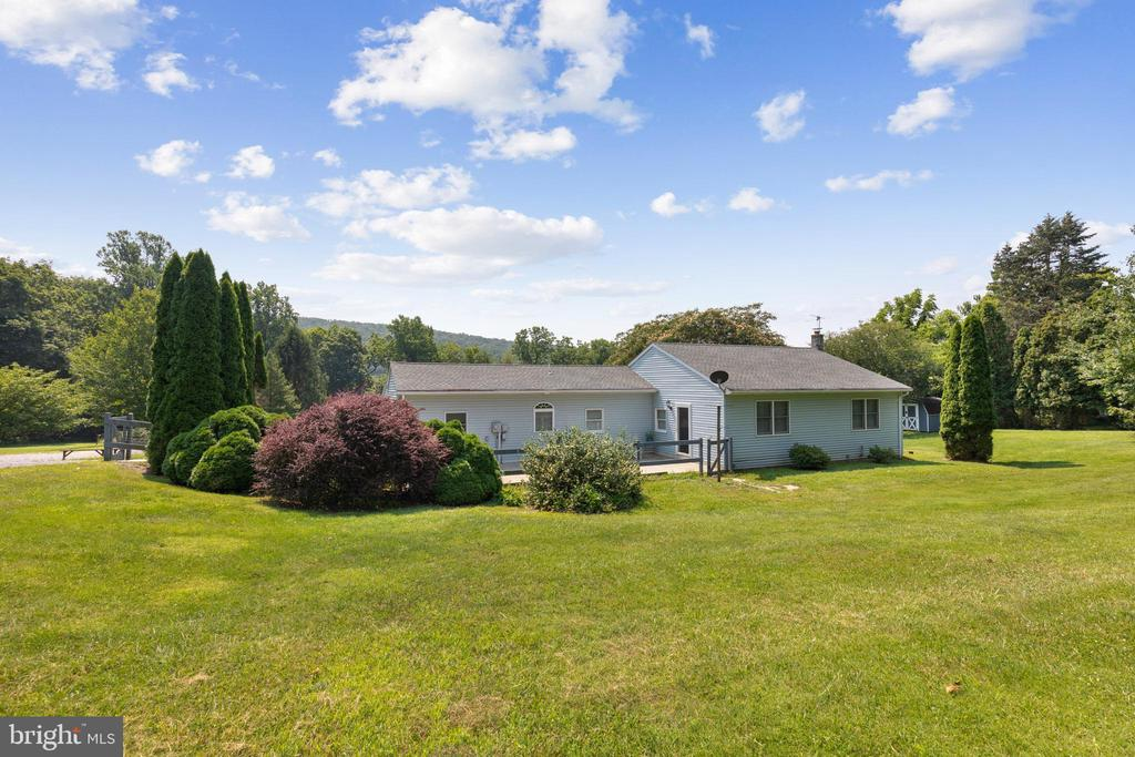 Welcome to 59 Longview Road, an impressive ranch home situated on 3 scenic and secluded acres. Located in USDA (0% down) mortgage eligibility area--don't miss your opportunity to build equity in an idyllic location. You have your choice of main entries in this special home—a fenced 300+ square foot front patio leads to a living room entry, or an inviting (recently repainted) rear deck leads to a dining room entry to the home. Entering from the 350+ square-foot deck, guests are greeted by an open concept main living area. A well-appointed kitchen features an abundance cabinetry, plenty of counterspace, a coffee bar area & stainless steel appliances--including gas range. The ample dining area looks out into the living room; complete with a large coat closet, ceiling fan, access to the side patio and a door that leads to a large bedroom. The 2nd bedroom includes a full bathroom and private sitting room which could easily double a nursery, if needed.  A full bathroom and office/den nook complete the main floor. Downstairs, the basement offers plenty of convenient storage space. Outside, on the rear deck, picturesque views of both manicured and wooded grounds provide a perfect setting to observe  wildlife and enjoy for your morning coffee. There are 3 large storage sheds on the property and parking for 10+ cars on the expanded driveway. The owner hates to leave; however, he needs to be closer to family in Bucks & Philadelphia counties at this time. He has made over $10,000 in improvements and repairs during his short ownership--as his intention was to stay for many years. A 1-Year First American Home Warranty is included in the purchase of this home. Very low property taxes! Showings start Saturday, 8/7/21.