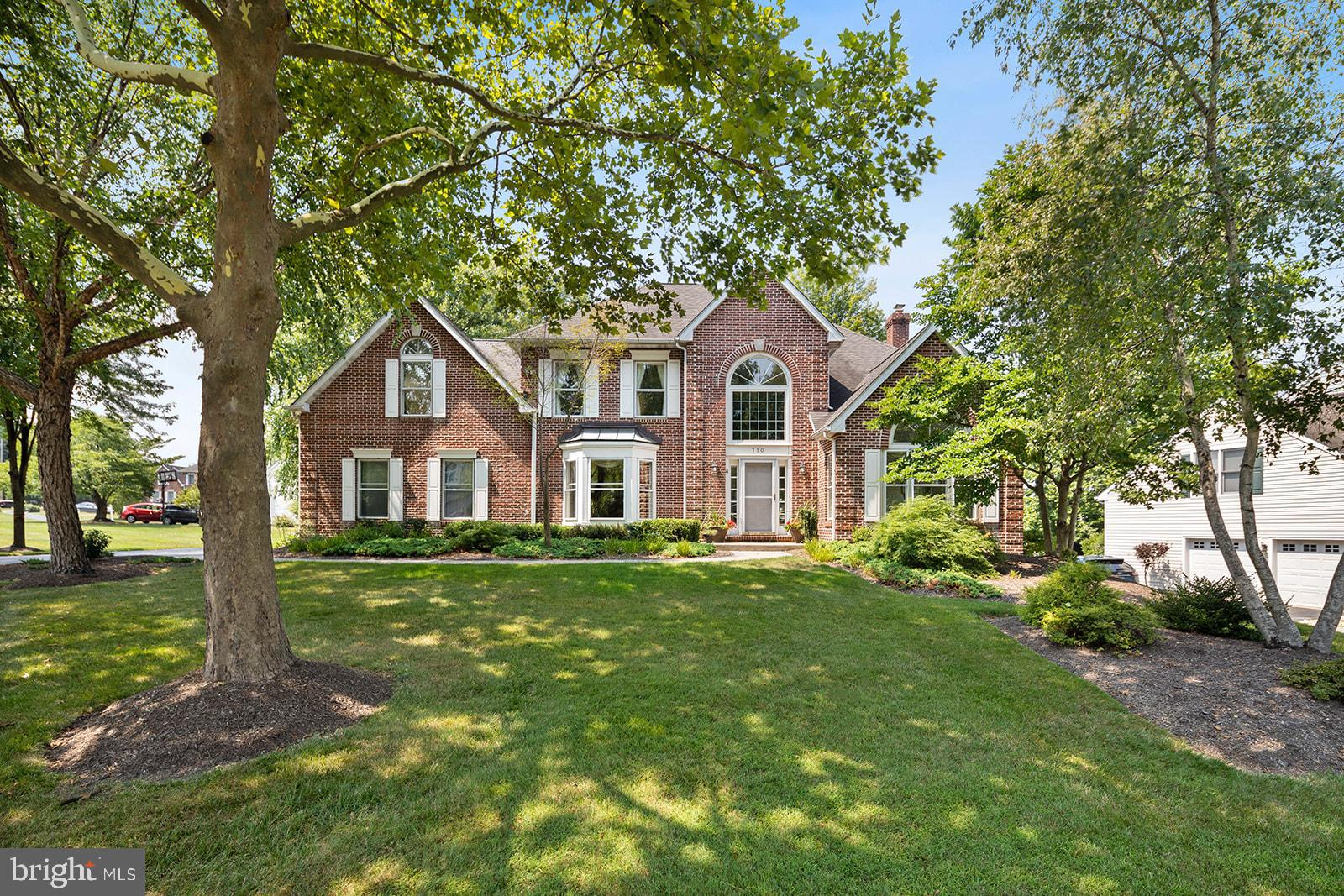 Move right in to this beautiful brick single-family home in Valley Forge Estates! 710 Outpost Circle is ready to welcome its next owners. You'll immediate notice the natural light throughout the home as you step into the front entryway with soaring ceilings. To your right is a perfect flex space with greenery views which the current owners use as an office and music room. To the left is a dedicated dining space perfect for large gatherings. Down the hallway the beautiful hardwood floors extend into the spacious living room with a fireplace. You'll love the updated kitchen with plenty of granite counter space, stainless-steel appliances, and eat-in area with a lovely window seat! Past the kitchen and through the mudroom/laundry area is the spacious two-car garage with an alcove perfect for additional storage. Enjoy outdoor dining and entertaining on your composite deck and large side yard. Back inside and into the fully-finished basement is plenty of room for a workout area, media room, office, or secondary living space with plenty of extra storage. Head upstairs to the second floor, featuring three spacious bedrooms with an updated hall bathroom. Down the hall is your spacious primary bedroom complete with a great walk-in closet and modern bathroom. Situated on a quiet cul-de-sac in Upper Merion Township of Wayne, this home is convenient to the King of Prussia Mall and Town Center, downtown Wayne, major highways, and nature trails like the McKraig Nature Trail and Bob White Park. Make an appointment and take advantage of all this home has to offer!