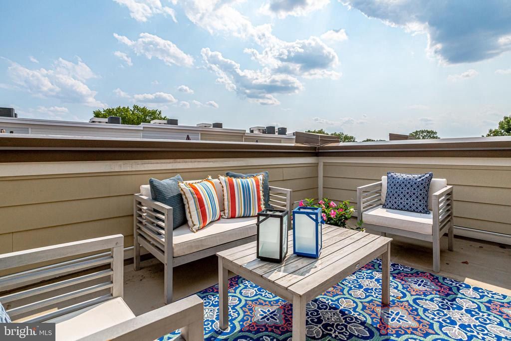 WONDERFUL CHANCELLORS ROW LISTING.    OPEN HOUSE SUN 9/12 2-4PM This is the one you have been waiting for in the sought-after Chancellors Row community in the heart of coveted Brookland.  This EYA-built, 7 years young, 3br+den/3.5ba beautifully appointed townhome delivers everything you've been searching for in your new home.  From the convenient in-town location, to the move-in ready condition, to the abundant spaces on each of its 4 levels, and topped off with a private roof deck with views for days, there is nothing that you can't check off on your must have list.  This home is ready for you to move right in and enjoy.    The main level is a show stopper with an open plan layout featuring a timeless, classic white kitchen with abundant cabinet space, expansive granite counters with breakfast bar, pantry, gas cooking, stainless steel appliances, updated pendant lighting, and a chic new herringbone subway tile backsplash.  The large scale living and dining spaces provide ample spaces for gatherings.  Wood floors, recessed lighting, a powder room, and a rear deck with a gas hookup for easy grilling round out the main level.  The entry level features a large welcoming tiled foyer and a spacious den/office with double doors, perfect for those who are continuing to work from home.  This space could easily be converted into a real 4th bedroom by creating a closet.  This level also leads to the spacious 1-car garage with extra room for storage. The two uppermost levels feature the primary bedroom and two additional bedrooms, each with their own en suite baths. The primary suite offers ample closet space with its big walk-in closet and a beautiful en suite bath with a large, tiled walk-in shower with built-in bench and a granite topped double vanity.  This level is completed by the 2nd bedroom with en suite bath, and the laundry station.  The top floor delivers the third spacious bedroom and third en suite bath, plus a large loft-like bonus space, perfect as a family room