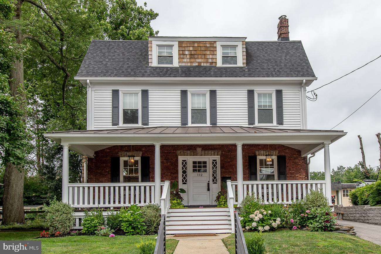 Welcome home to this stunning, move-in ready Dutch- Colonial, located in the highly desirable Narberth Borough that is a block away from everything...the train station, post office, bank, eateries, bars and a park!  Situated in the center of the block, this home has 3,000+ SF of updated living space.  Walk up to the beautiful covered mahogany porch and enter into the light and airy first floor. Open living room offers a cozy wood burning stove anchored by 2 custom storage benches as just one of the fabulous focal points in this room.  Enter into the main dining room and the family room from the wood/glass French doors adjacent to the main level family room living space.  The attention to detail in each room is well thought out by the current owners and out of architectural digest! Shiplap around fireplace and main level coat wall are eye-catching, exposed original brick wall to second level.  Gourmet eat in kitchen with black Quartz counter tops, custom backsplash, all new top of the line stainless steel appliances, center butcher block island and side butler pantry.  Powder room completes the beautiful main level. Access to spacious and fully fenced in backyard (leveled and perfect for family entertaining), private driveway for 4 + cars and EP Henry patio. Lots of large windows with new window treatments throughout main level bringing in the natural light.  The 2nd floor has three generously sized bedrooms with abundant closet space and upgraded large hall bath.  The third floor large master suite is its own private oasis with new walk in his/her custom closet along with another large closet, renovated gorgeous spa like master bath and cozy sitting area for additional home office space. Full lower level renovation in 2021 is fully finished with a magazine worthy laundry room, playroom and workout space AND radiant heat floors.  This sought after location is also minutes to Suburban Square, Wynnewood and Main line private and public schools.  Center City an easy com