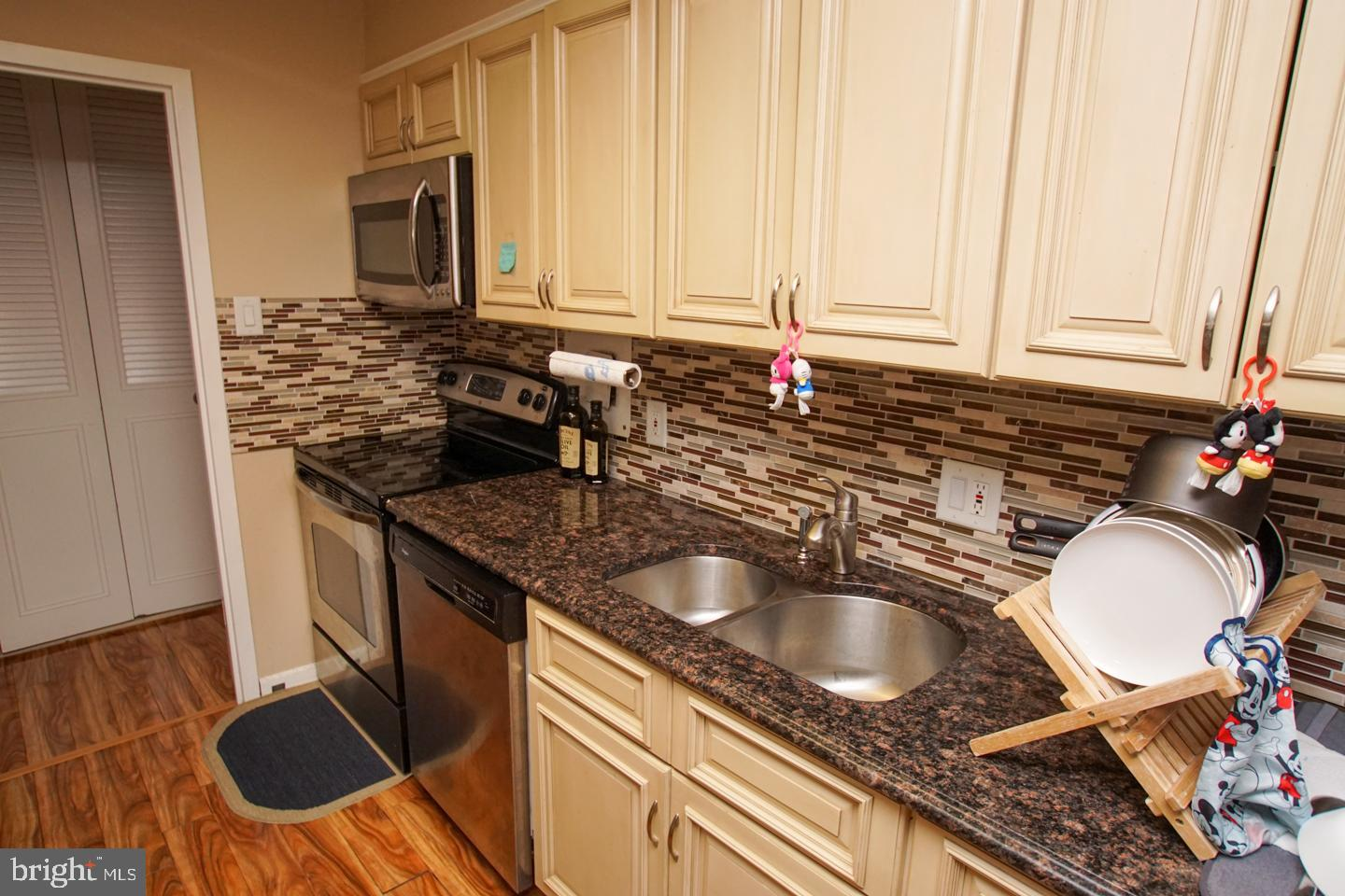 Welcome to this beautiful condo located in Wynnewood! The West building has been completely renovated. The property features an open floor plan with an amazing central island. Granite counter tops and stylish backsplash really make this kitchen pop. Open floor plan will not disappoint! The unit itself has been updated tremendously.. stainless steel appliances, new bathroom fixtures, new hardwood floors, and updated closets. Enjoy all the amenities that come with this property. The Green Hill complex has pools, a private shuttle service, common rooms, landscaping, covered parking, and all utilities! Come view this property before it is too late!