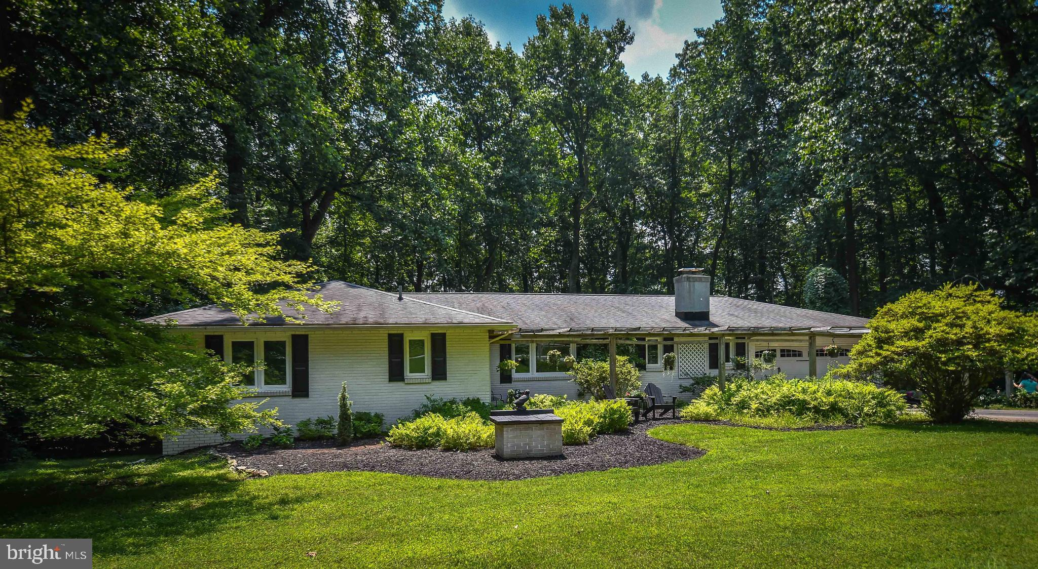 Welcome to Blackberry Lane and Charlestown township.  This is an exceptionally well maintained ranch home sitting on two plus acres that is now ready for its new owners.   This home boasts a maintenance free exterior, new central air system (2020), new how water heater(2021), updated Heater (2019),  Sylvan swimming pool, and 2 car garage.  Single floor living at its finest  with a large living room with hardwood floor and expansive picture window offering natural light and views of mother nature.   There is a wonderful primary bedroom with hardwoods and full on suite bathroom.  Two additional bedrooms that are both very functional in size, one of which overlooks the expansive back yard.   The dining room over looks the back deck that has both a covered area and large area to enjoy the sun while overlooking the pool.  The kitchen has lovely counter space and has recently been updated  with a new stove  and refrigerator.  Off the kitchen there is a sizable living room that is equipped with a fireplace and sufficient room to offer a breakfast room or dedicated office.   Downstairs you will find a partially finished  basement ready for fun and also tons of storage.  The home is located in Charlestown Twp which provides and incredible quality of life.  Charlestown has preserved almost 40% of the township  as open space  to protect its rural make up while being delicately tucked between  both Malvern & Phoenixville.  The property is in walking distance  to Brightside farm park, moments from dining and entertainment,  all while being in the shadows of major employers, commuting routes, and the Great Valley School System.