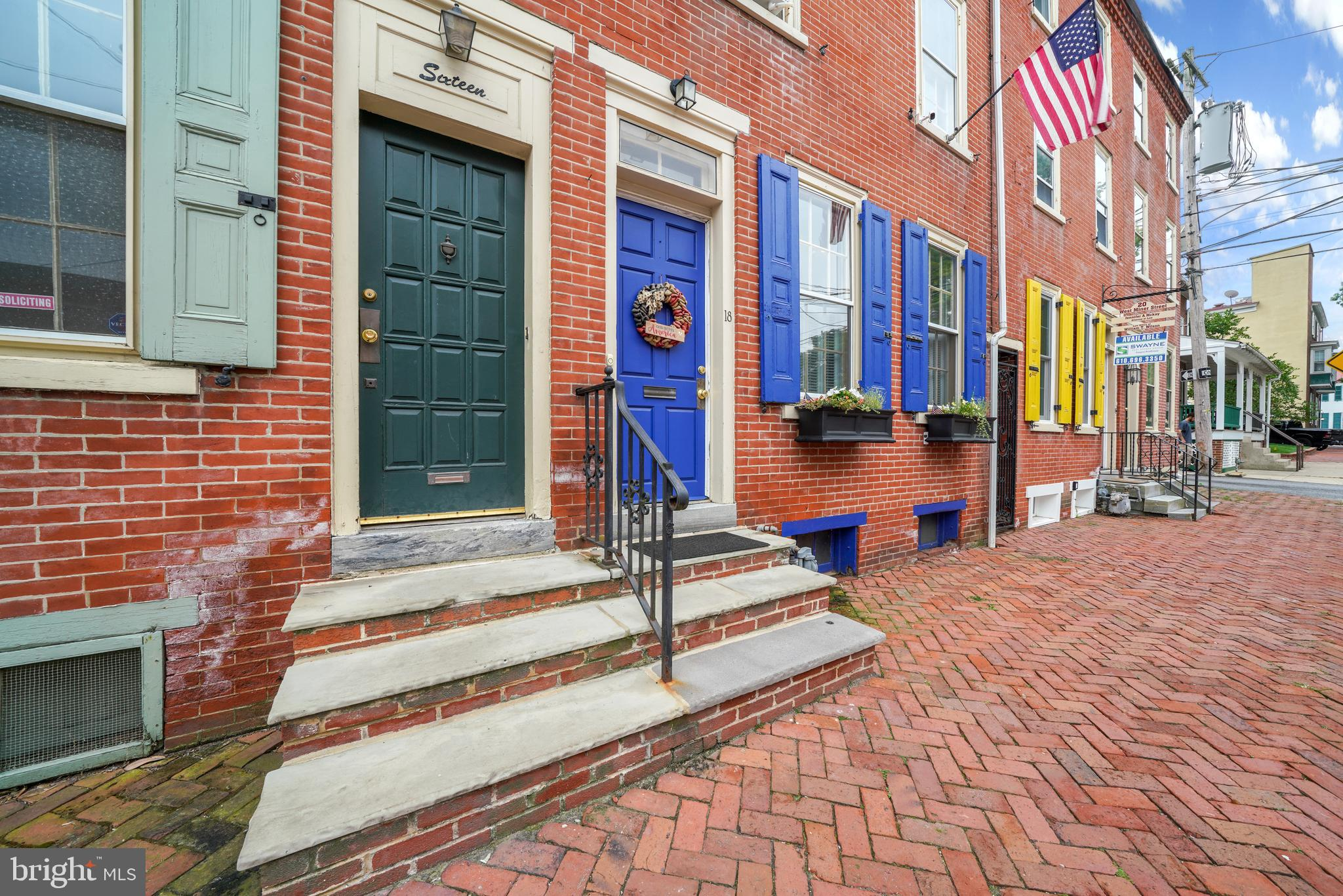 Welcome to The West Chester Borough – A turnkey classic brick row previously included on the West Chester Library Home Tour. This property features 4 Bedrooms, 1 Full Bathroom, 2 Half Bathrooms, hardwood floors throughout, Fenced Rear Brick Courtyard and two car garage with 2 additional parking spaces (separate parcel included in sale). The main floor of this light and bright home features Living Room/Dining Room with built-ins, Fireplace, new updated Kitchen (2018) with Floor-To-Ceiling Cabinetry, Quartz countertops, Gas Cooking, Stainless Appliances and Breakfast Bar, Mudroom with Brick Floor and Half Bath. The second-floor features 2 Bedrooms, Sitting Room with skylights, One Full Bath, One Half Bath and Laundry. The third-floor features two spacious additional bedrooms, one currently utilized as an in-home office with exposed brick. Located close to West Chester University, West Chester's Downtown, and all major highways. Don't miss out this quintessential West Chester Borough home.
