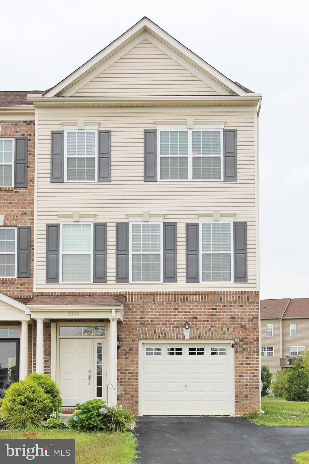 """Welcome home to the largest end unit townhome in the highly sought after Village of Bayberry,  having 2,425 square feet.  Park in your driveway that has an additional spot for family or guests. Enter the lower level having a sizeable foyer, access to the garage, and a room that could be your home office or great room with sliders to your backyard. Making your way upstairs you will notice the abundance of windows in this wonderful sunny open floor plan. The gourmet kitchen has 42"""" Espresso cabinets, and ample counter space that leads to the sunroom with sliders to a composite deck, perfect for entertaining. The upper level has a master bedroom with a large walk in closet and a master bathroom with double vanities and shower. Two generous-sized bedrooms and hall bathroom complete this level. All bedrooms have ceiling fans! Enjoy the countless amenities Village of Bayberry has to offer like walking trails, playgrounds, fishing and boating on a private lake, and the beautiful lake house which is  available for private parties and events. Easy access to major roads and interstate with no tolls. Your search is finally over. Schedule your tour today!"""
