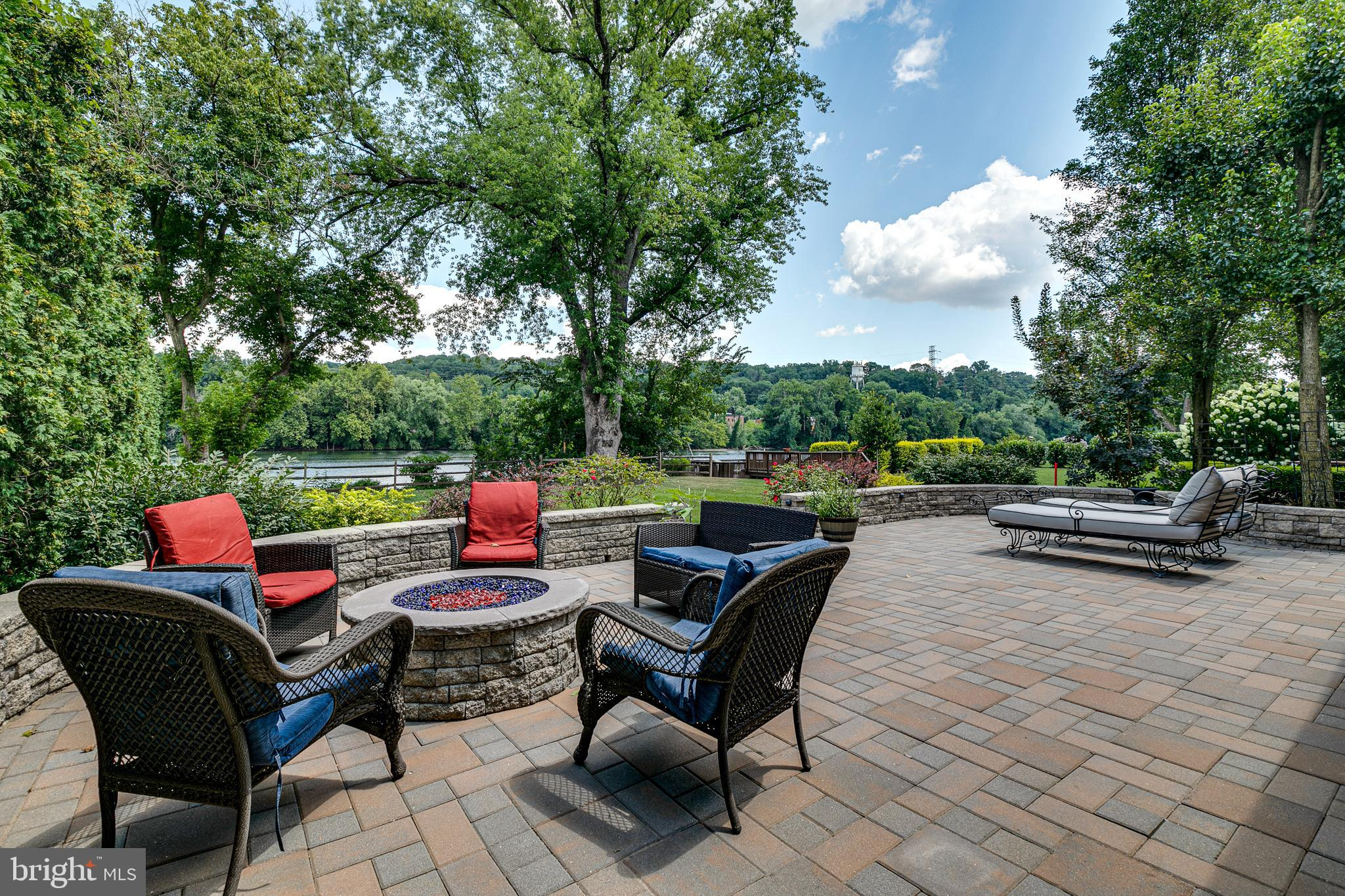 """This beautiful home with river views is nestled in the very coveted neighborhood of Gladwyne.  The setting feels bucolic with lush green and water views, juxtaposed with the conveniences of all that is Gladwyne.  The home was designed with proper reverence for the water, with sliding glass doors and large windows allowing river views from every room in the house. The main floor boasts a spacious living room with a fireplace with a marble hearth and mantle, a separate dining room, powder room and a brand new kitchen with 42"""" white cabinets, Quartz countertops, stainless steel appliances and subway tile backsplash.   This entire floor beams with light and leads out to the deck through two sets of 12' foot sliding doors that overlook the lush yard. The 3rd floor features 3 spacious bedrooms, 2 full bathrooms and the laundry area with washer and dryer. The primary suite feels like a private retreat and offers a large bedroom, a generous walk-in closet and a gorgeous bathroom with a glass enclosed marble shower with a rain shower, hand held shower fixture and body spray fixtures.  The upper level with a fireplace and balcony overlooking the trees can be used as the 4th bedroom or media room.  The ground floor is ideally situated with a home office with sliding doors leading out onto the back patio along with access to the 2-car garage.  Outside enjoy the EP Henry paver patio with accent lighting and a built-in gas fireplace.  This is a nature lover's dream -with kayaking, paddleboarding and fishing from your own backyard. Quick commute to Center City, easy access to Manayunk, 76, 476 and King of Prussia.  All located in the award winning school district of Lower Merion."""