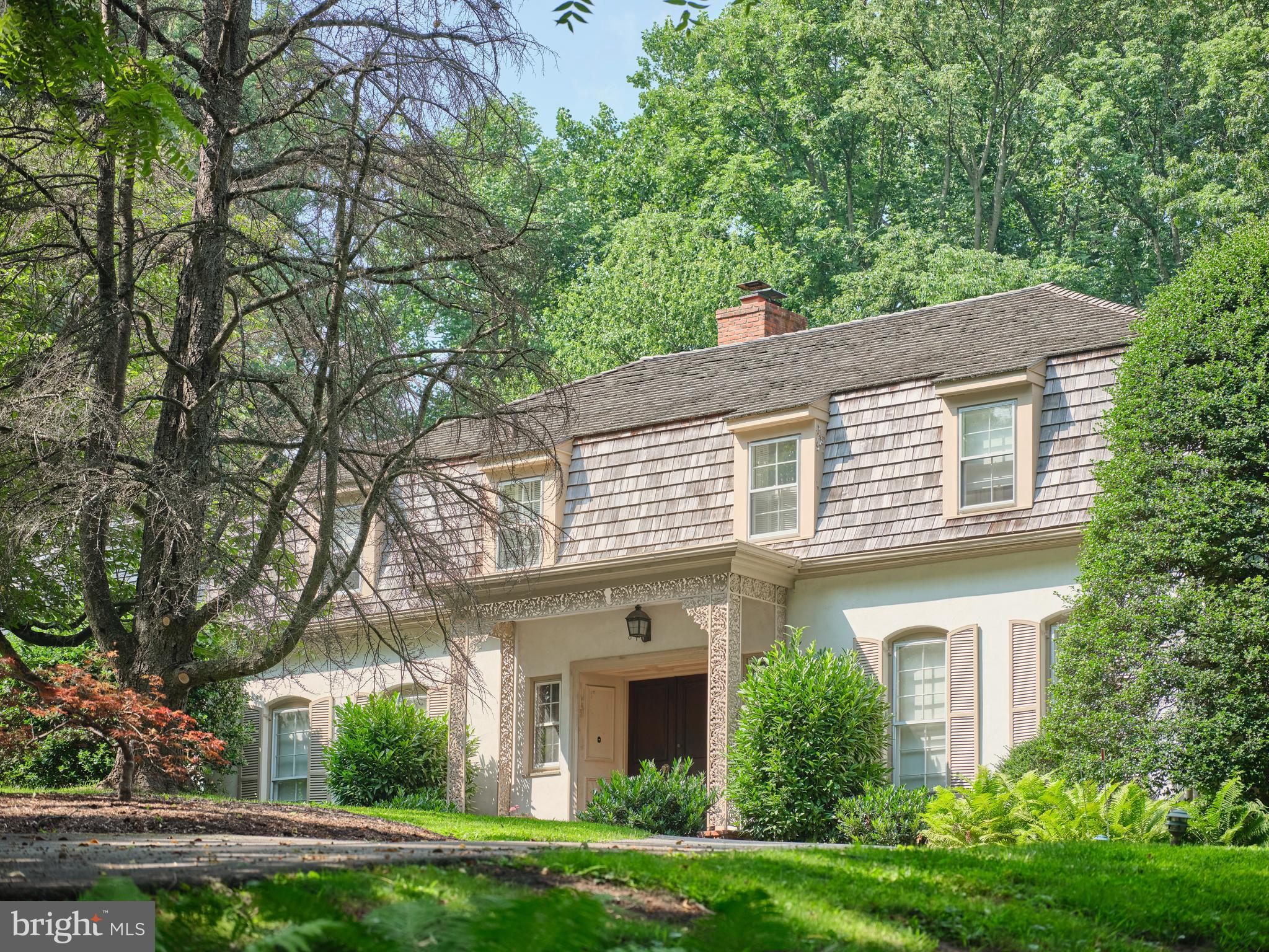 Ideally located on a park-like 3.47-acre parcel at the end of a private lane in Lower Merion's North-side Villanova find this classically styled 4-bedroom 4.2 bath home. Set on a slight rise to capture the sun and long views in all directions, the home, built in 1968 offers a timeless floor plan with formal Dining and Living spaces and an eastern facing Kitchen that flows into the fireside Family Room. A deep terrace off the rear of the home connects the informal spaces to the pool, backyard, and entertaining areas. From the entrance foyer a sweeping stair leads to an elegant Primary Bedroom suite with three exposures of light, generous his and her closet space and wood burning fireplace. Three additional spacious bedrooms and 3 baths, two en suite, one  with custom shelving ,make use of either the front or rear stair. A  hand split cedar shingle roof was the most recent update to this beautifully constructed and designed, well-loved single owner home. Please note that some of the photos are virtually staged.