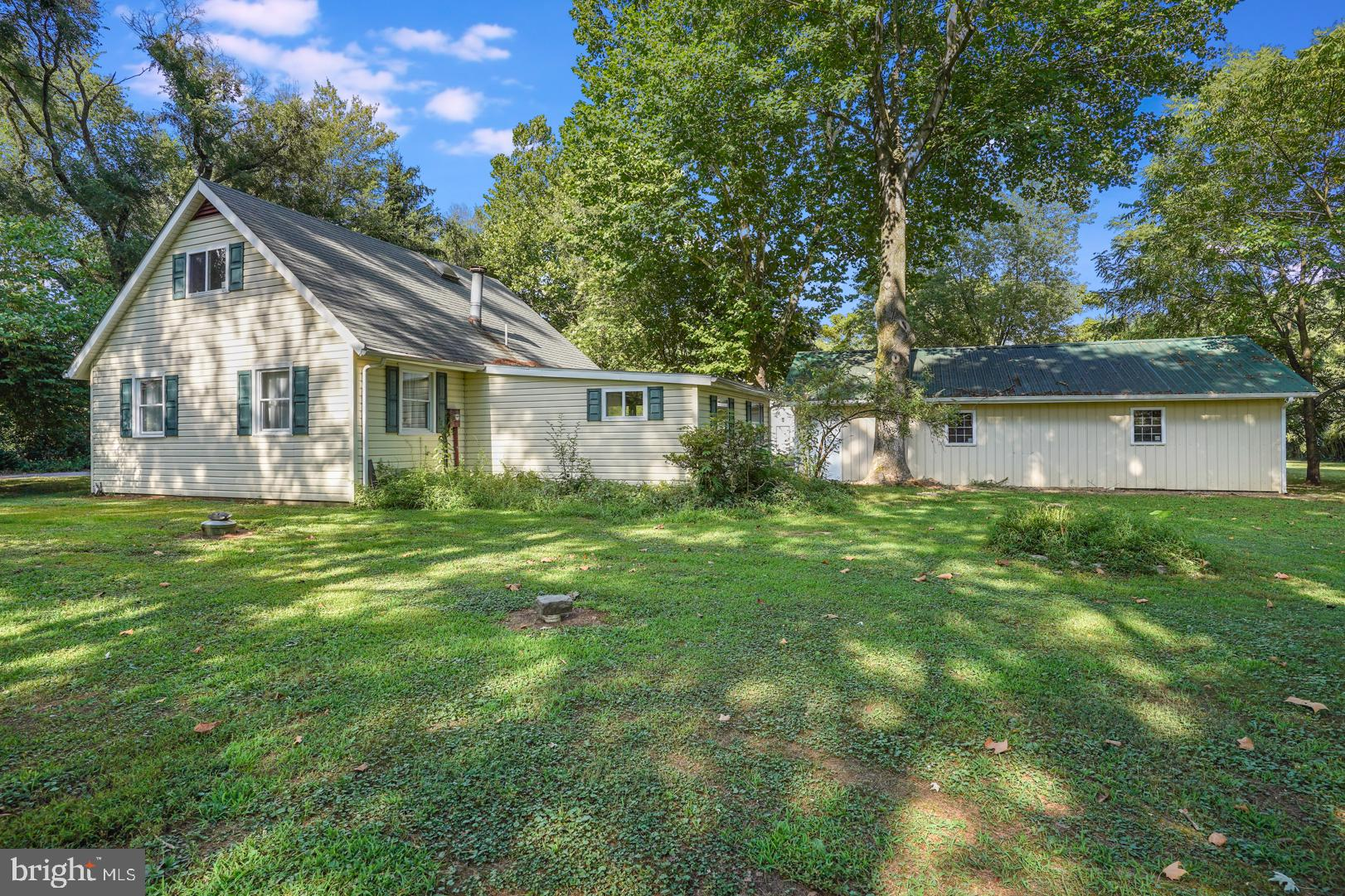 Truly a must see!  This Cape Cod sits on a well-maintained 3.5 acres.  A car enthusiasts dream!!!! Endless opportunities with a 100 x 50  / 5 bay garage & an additional 2 car garage!  New Septic is being installed .