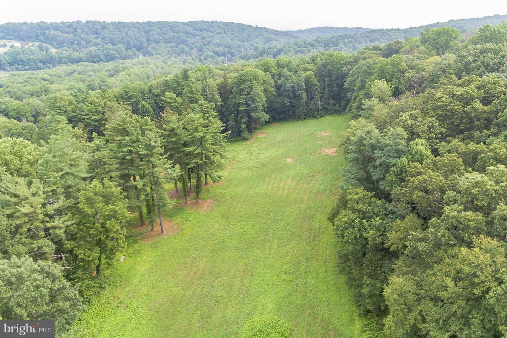This is a great opportunity to build on a beautiful 19+ acre lot in East Nantmeal Twp in Glenmoore. This lot is ready for your dream home; with acres of trees surrounding the building envelope and an abundant amount of open space as well as a pond and bank barn! Come and experience this beautiful lot for yourself! Book your showing today.