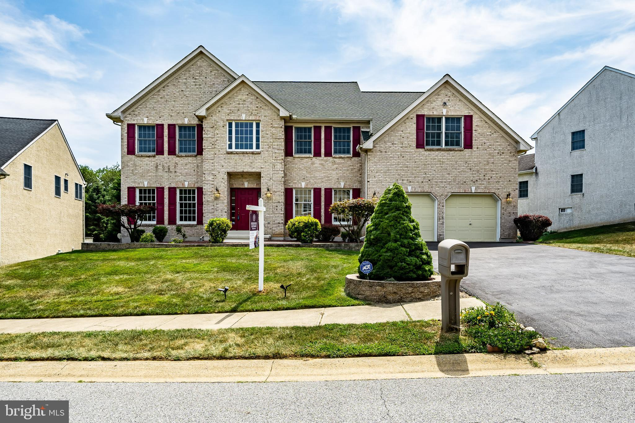 This Hills Of Hockessin original owner home, has been carefully updated and impeccably maintained. RECENT UPDATES; HVAC(6 years),  50 YEAR ROOF(3 Years) WITH TRANSFERABLE WARRANTY,  HOT WATER HEATER(2 years), BRAND NEW KITCHEN APPLIANCES, NEW MASTER SHOWER ROOM(1year).  As you pull up to the front of the home, you will be impressed with the curb appeal, brick front and well manicured landscaping.  Step into the front foyer and fall in love with the hardwood floors, that extend through the entire home. The numerous large windows make this a very bright home. The 2 story foyer, architectural details of columns and arched doorways will immediately impress you.  The formal living and dining rooms flank the front foyer. The family room will provide a cozy space for get-togethers, as everyone enjoys the gas fireplace, floor to ceiling windows and vaulted ceiling. The kitchen is open and adjacent to the family room. The quartz counter tops, 42 inch cabinets, center island, never used stainless steel appliance will satisfy the most experienced cook.  The nearby breakfast nook provides a nice place for meals, with the slider access to the rear deck just nearby. Enjoy the view of the open space and rear pond from your deck. When it is time to travel to the 2nd level, choose from either the front or back staircase, but don't miss the overhead views of the front foyer, catwalk or the view of the family room, The owner's suite is the center piece of the upper level. As you pass through the double door entrance, you will find a generous sized sleeping area and separate sitting area.  The sumptuous master bath presents a double vanity, soaking tub, updated shower and commode area.  The 2 oversized walk-in closets will eliminate any discussion regarding closet space.  The well sized additional 3 bedrooms and 2nd full hall bath, completes the 2nd level. The walk out lower level could add significant living space to the home. The 2 car attached garage will certainly come in handy. Th