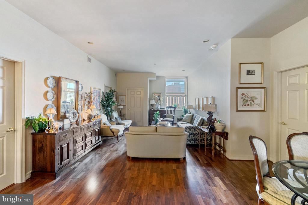 Just what you have been waiting for!  PARKING INCLUDED!  Welcome to The Phoenix . This immaculate 2 bedroom/ den or can be 3 bedrooms was decorated by a designer with gorgeous finishing touches throughout and lovingly maintained.  As you enter this condo, you will be greeted by stunning hardwood floors . Beautiful open floor plan,  The chef's kitchen opens up to the dining area with gleaming granite counter tops, stainless steel appliances and island breakfast bar. Pantry off to the side and laundry area with storage, Off to your left  features currently  a home office but large enough to serve as another bedroom with fabulous built in cabinets and desk. The large master bedroom with very own master bath that features a stand up tile shower, full bath and beautiful granite vanity  is equipped with ample space and closets.  The second bedroom is currently used for a family room  and features built ins for media center and another full bath with granite vanity and tile floors. This is an amazing condo and move in condition . The Phoenix is  5-star amenity rich building with 24/7 concierge , stunning roof top terrace , fitness center, media center, conference room,  and most of all,  direct access to Suburban Station right from the residence elevator to make travel so much easier. There is a full service restaurant on site,  along with Starbucks Cafe . A short walk to Rittenhouse Square and the many restaurants or visit the many museums such as: The Barnes, Philadelphia Art Museum etc. Easy access to 176 and I95 make this a carefree lifestyle.