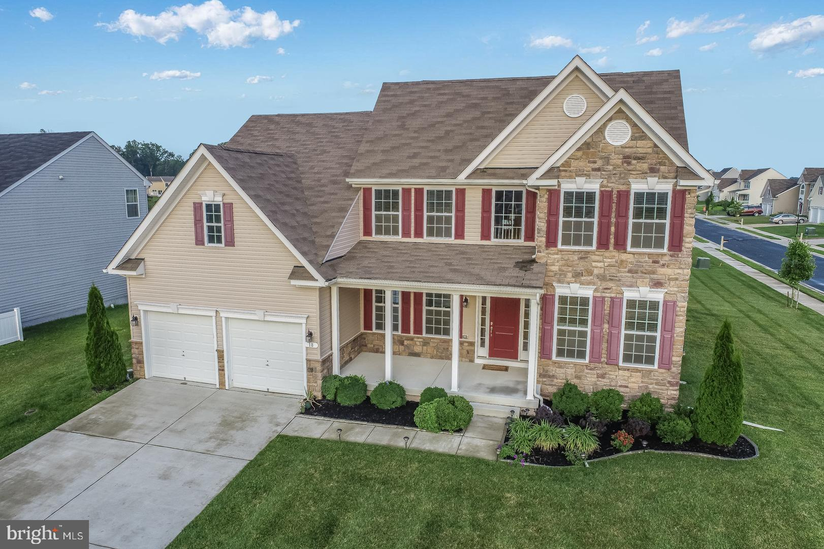"""Don't miss this remarkable home in the desirable community of The Reserve at Chestnut Ridge. The house was built in 2017 and has many wish-list features: gleaming hardwood floors, recessed lights, custom blinds, stone accent in the front of home, inviting porch, and a walk-out basement. It offers an expansive floor plan with 4 bedrooms and 3.5 bathrooms, a stunning 2-story family room, formal dining room, and an office with French doors. The kitchen has custom quality 42"""" maple cabinets that provide ample space, a central island, and a large walk-in pantry; it opens to the Family room and a beautiful sunroom overlooking nice and open back yard.  The main bedroom suite is conveniently situated on the first floor and offers a generously-sized bathroom,  double vanity, and a walk-in closet. The walk-out basement is finished and features a spacious recreation room, a den with a kitchenette, and additional bathroom - it's perfect for in-laws, guests, and entertaining. The house is nestled on a corner lot with a lush lawn, beautiful landscaping, and a sprinkler system. Freshly painted, the home is simply waiting for its new owners! The excellent location makes this home even more attractive; it is a 5 minute drive to Rt. 1, a 10 minute drive to Dover Air Force base, and a 40 minute drive to the beaches, easy commute to shopping, restaurants, and schools. The Reserve at Chestnut Ridge is a flourishing community that offers walking trails, a Clubhouse featuring a gym, party rooms, TV lounge, 2 in-ground pools, and a fenced-in playground. This is a truly must see home! Call the listing agent to schedule a tour."""