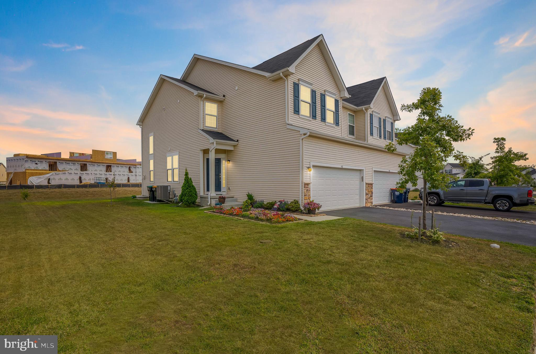 """Welcome to 410 Galway Court in the sought after community of Hyetts Crossing! This 3 bedroom, 2.5 bath twin home was built in 2017, offering you the new construction feel without the wait! As you enter, you will immediately fall in love with this home's open floor plan, showcased by a large open foyer and beautiful, dark hardwood floors throughout. The spacious gourmet kitchen boasts granite countertops, new stainless steel appliances, tile backsplash, plenty of cabinet space, and a large center island with seating! The kitchen opens up into a beautiful 2-story great room with numerous large windows, allowing for lots of natural light throughout the living area. The tall ceilings and cozy wood-burning fireplace will make this your favorite room to relax or entertain! A sliding glass door gives you access to a brand new patio—the perfect spot to read a book or enjoy your morning coffee. The second level features a balcony overlooking the downstairs living area, allowing the natural light to continue upstairs. The master bedroom has a sizable walk-in closet and an ensuite bathroom with a large tile shower with glass doors. The second floor features 2 more bedrooms (one with another walk-in closet!), another full bathroom, and a laundry area. The finished basement has plenty of room for you to create your home office, play room, or """"man cave"""", plus a large utility room for storage. All of this plus the 2-car garage and delightful curb appeal of this home make it one that you don't want to miss!"""