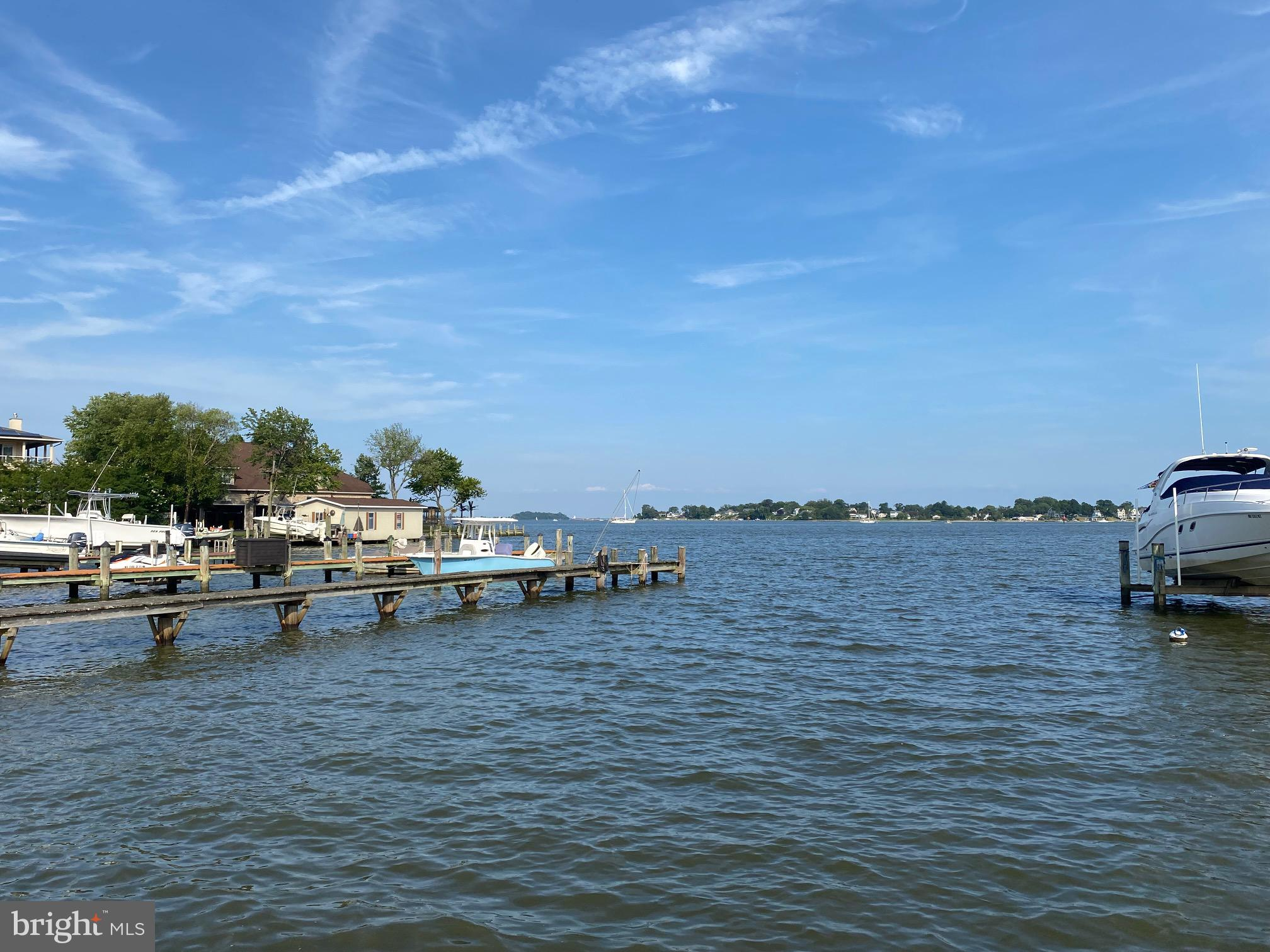 Phenomenal Opportunity to build your dream home on this 20000 square foot Waterfront lot with spectacular views of Selby Bay and South River and even the Bay . Large flat building envelope  w/existing detached garage on this site . Public Sewer,Private Well , 80' of Riprap waterfrontage,cleared lot w/Engineering already underway thats complimented w/Deep Water perfect to build your own private Pier. Dont miss this chance to design your dream