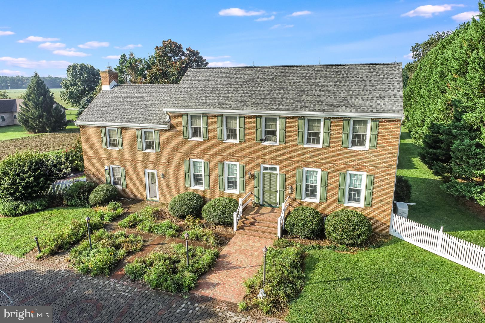 This Georgian colonial is a historic reproduction of  the Lewis mansion. THE SELLER IS OFFERING A HOME WARRANTY! It is located in the desirable Caesar Rodney district and sits on 2.5 acres. The tree lined driveway is accentuated by post lanterns leading up to the colored pavers in front of the entrances. There is a gourmet kitchen with custom cherry soft-close cabinets, granite counters, commercial 6 burner gas stove, breakfast bar, pet feeding station, Oyster Cove ceramic tile floors, a gas insert in the fireplace, and artesian tin fixtures custom created by a local tin smith. (There are five additional decorative fireplaces throughout the house.) The bathrooms have Carrera marble counters, limestone floors, rain head showers, bidet toilets, and whirlpool in the owners bath. The main entrance hall has the central staircase and Vermont Serpentine marble flooring. A second staircase leads from the kitchen to the second floor. Additional highlights include hardwood floors, crown molding, and 9 foot ceilings. There are roomy closets, storage, and shelving throughout the house. An ADT security system is wired with cameras and an outside siren in addition to a whole house generator. No need to worry— the architectural shingled roof has a warranty to 2066, the HVAC is new in 2021, and the septic was inspected in 2021.