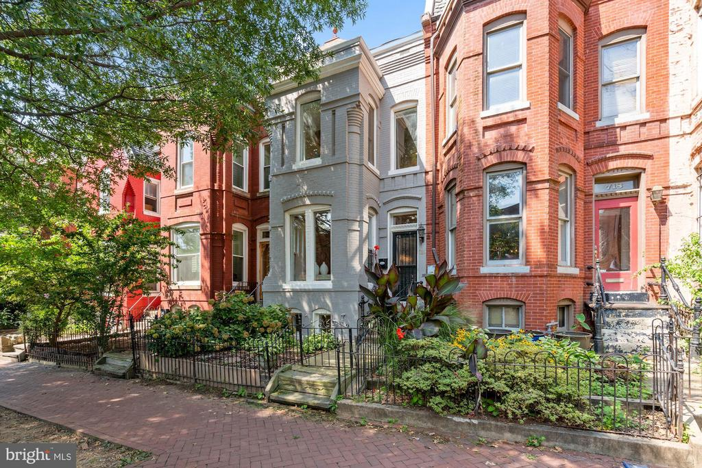 You really can have it all - location, size, abundant outdoor space and parking!Historic 1890 Queen Anne-style rowhouse nestled on an idyllic tree-lined block in a prime location at the intersection of H Street, NoMa and Capitol Hill. Gleaming wood floors, big windows, warm exposed brick and impossibly high ceilings are coupled with an incredibly deep rear garden AND two car parking accessed via a wide alley.  The main level features an open flow from the spacious living room through the dining room to the convenient powder room and sunny kitchen. Beyond the kitchen is the amazing rear garden - something rarely found in this location. Show off your green thumb, entertain with style in the great outdoors, or just relax outside with a cool iced tea while you WFH - the choice is yours! Your frustrating days of searching for parking are finally over thanks to the abundant parking for multiple cars right out back, and you're a short stroll to Union Station for Metro.  Upstairs, you'll find two bedrooms with great closet space and exceptionally high ceilings. Conveniently located laundry, a full bath with a romantic clawfoot tub and the perfect space for a sunny home office that could easily be enclosed to form another bedroom, den or nursery if you need 3 bedrooms up. The lower level has full ceiling height, two more rooms that would make a great guest suite or family space and the second full bath. Welcome home!