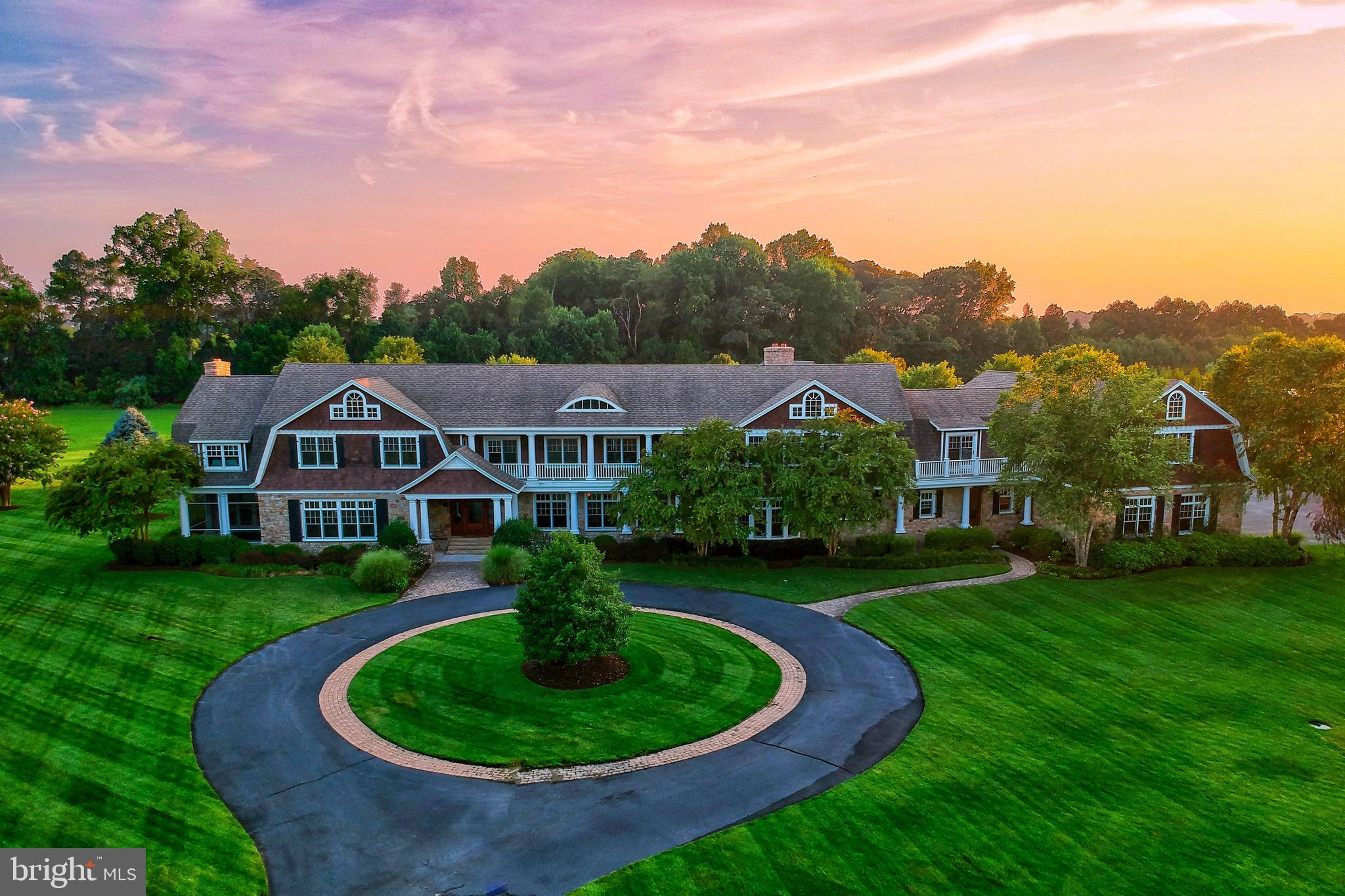 """Welcome to Stonewater Farms, an incredible 13,739 sf waterfront estate located just minutes from the Delaware Beaches. This is a true one-of-a-kind estate that sits on over 10 acres along Herring Creek, with a private horse stable, 3 large horse pastures, private floating dock with jet ski lifts, a  4,000 sf concrete floor pole building, an in ground pool, and so much more! This Hamptons style, stone and cedar shake,  fully custom home is built like none other in the area with 2""""x6"""" framed walls, Advantech sheathing,  and over 250 tons of 8"""" thick stone around the entire first floor exterior of the home! At just under 14,000 sf this home features 6 bedrooms, 9 bathrooms, oversized 5 car attached garage, large mud room, a home theater, 2 separate home gyms, a full custom bar in recreation room, large home office,  5 fireplaces, newly refinished kitchen with top tier Sub-Zero and Wolfe stainless steel appliances, grand dining room with 24' custom table, greatroom with stone fireplace, formal living room, geothermal HVAC systems, Anderson 400 series windows, wide plank oak floors, 8' doors, coffered ceilings,  stream shower, 2 screened porches, pool house, and many other luxury finishes throughout. This estate gives both luxury and privacy, all while being just minutes from the Rehoboth and Lewes beaches, shopping, golf and restaurants. This is a perfect oasis for someone looking to escape the hustle and bustle of the city or for anyone looking to gain privacy. Boating access to Herring Creek, Rehoboth Bay and Atlantic Ocean.  A truly one-of-a-kind property that could not be replicated and is priced well below replacement costs. Don't let this opportunity to own one of Delaware's premier estates slip away! Low property taxes. Adjacent 4.71 acre waterfront lot also available (MLS Listing: DESU2002704)."""
