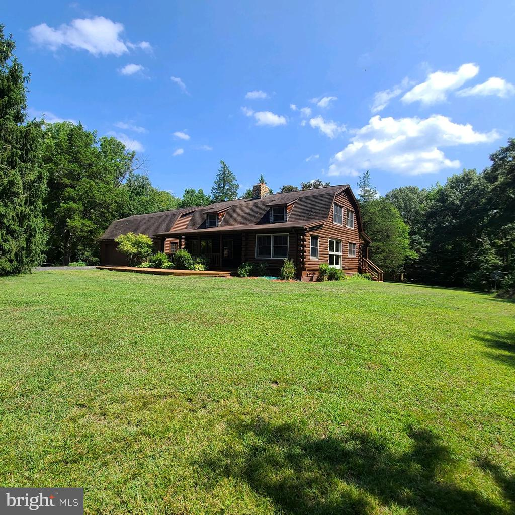 This gorgeous log home is nestled on over 12 acres and conveys with three additional lots for a total of nearly 40 private acres! If coming home to a peaceful, sirene and private setting with private atv trails, walking trails, riding trails, private firing range with natural berm backstop, 2 sheds and covered fire wood storage that is not too far from Fredericksburg, Dahlgren, Southern Maryland, Quantico, and Richmond is what you're looking for, then look no further, this is your oasis! This home boasts a detached 4-car garage with flex space above, completely new exterior front deck, new back deck steps, recently stained entire exterior logs, newer windows, Reliance controls partial home panel for generator with exterior connection for generator, water softener treatment system, newer well pump, wood burning stove and separate wood burning fireplace, huge walk-in pantry, and finished basement with a wet bar.  You won't want to miss this home!