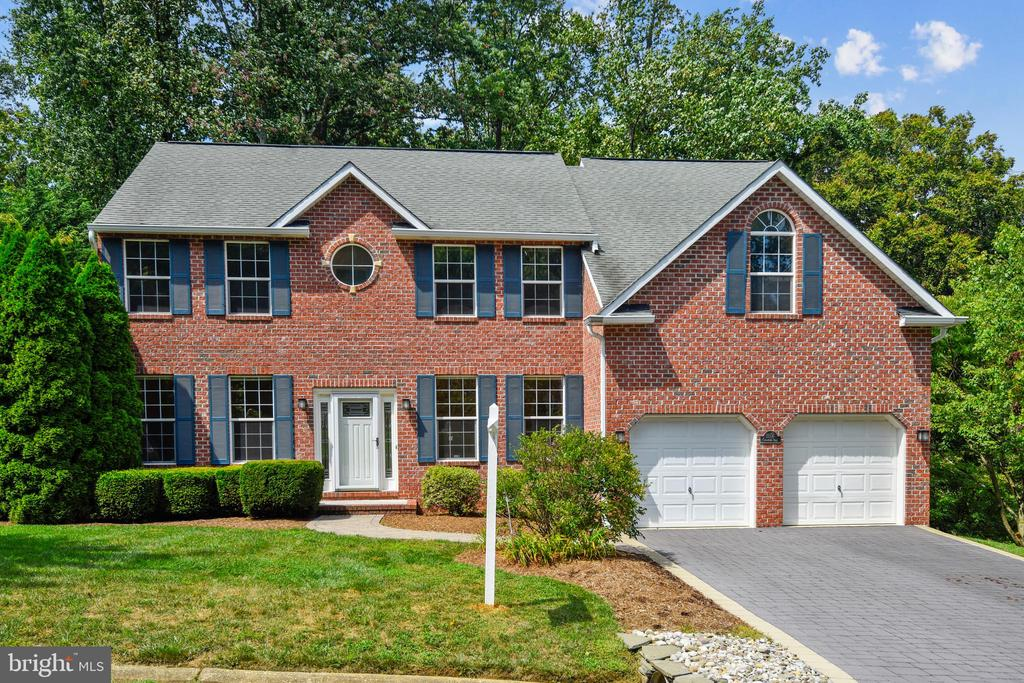 """3918 FINISHED SQUARE FOOTAGE of pristine living space await you in this one owner home. Move-in ready with many upgrades and refurbishments. New carpet & paint throughout. Custom-designed brick front Colonial built on a premium 27,436 sq. ft. wooded lot graded for walkout basement. 0.63 acres of professionally landscaped lot with mature trees and shrubs including large Magnolia tree & Cherry tree. The view from the multi-level deck is of lawn and woods offering a private peaceful setting. Spacious, light-filled main floor consists of entry foyer, living room, dining room, hall and half bath all with newly refinished hardwood floors. Large, two-story Family Room has multiple windows including a Palladian Window that overlooks the trees, and new carpet. The main level office is carpeted, kitchen has 2020 vinyl flooring. Gourmet Kitchen will not disappoint with recent total makeover of GE Profile stainless steel appliances, stainless steel sink and faucet, light fixtures and hardware. Kitchen cabinets are Natural Maple. Corner Pantry and new door to garage. Andersen exterior glass door opens to 1160 sq. ft. deck. The owners' suite was designed to include a sitting room, sleeping area, custom twin walk-in closets, custom bath with soaker tub and separate shower, tile and fixtures recently updated. Bathroom cabinets are Frosted Maple. New frosted glass bathroom door. Three additional bedrooms, a second bathroom, and a laundry closet are also on this floor. New faucets and toilets in all bathrooms. Construction has just been completed on the lower level of the home. Walls have extra insulation for comfortable living year round. The lower level consists of a recreation room, bedroom with 2 windows, full bath and 300 sq. ft. utility/storage room. Andersen French doors open to 440 sq. ft. ground level circular paver stone patio. Nine feet of built-in floor to ceiling cabinets near exterior doors. Wall unit with four 28"""" x 86"""" x 15"""" bookshelves with doors included. This floor"""