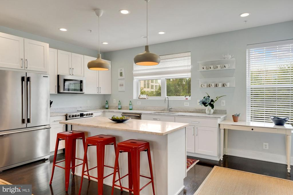 Gorgeous 3 bedroom/2.5Bath condo with private rooftop deck overlooking the Basilica within minutes to Brookland metro. Welcome to Brookland Station, a condo that lives a large as a townhome. Just 6 years old, this 3 level home is replete with high end features and finishes. The sunny and spacious chef's kitchen includes ample work space on Carrara marble counters, undercount sink, Frigidaire Professional series SS appliances, shaker style white cabinets, and a large island for extra seating. The open concept living and dining room are perfect for entertaining family and friends. Heading upstairs are 3 bedrooms and 2 full baths. The primary bedroom faces east abounding with natural light and includes a ensuite bath with double bowl vanity and shower/tub combination. Heading to the 3rd floor is the incredible private rooftop patio with gorgeous views of Brookland and the Basilica.  5 minutes to Brookland metro, Brookland Pint, and all the shops along Monroe St. .4 miles to Primrose, Right Proper Brewing Co., Annie's Ace Hardware and much more.