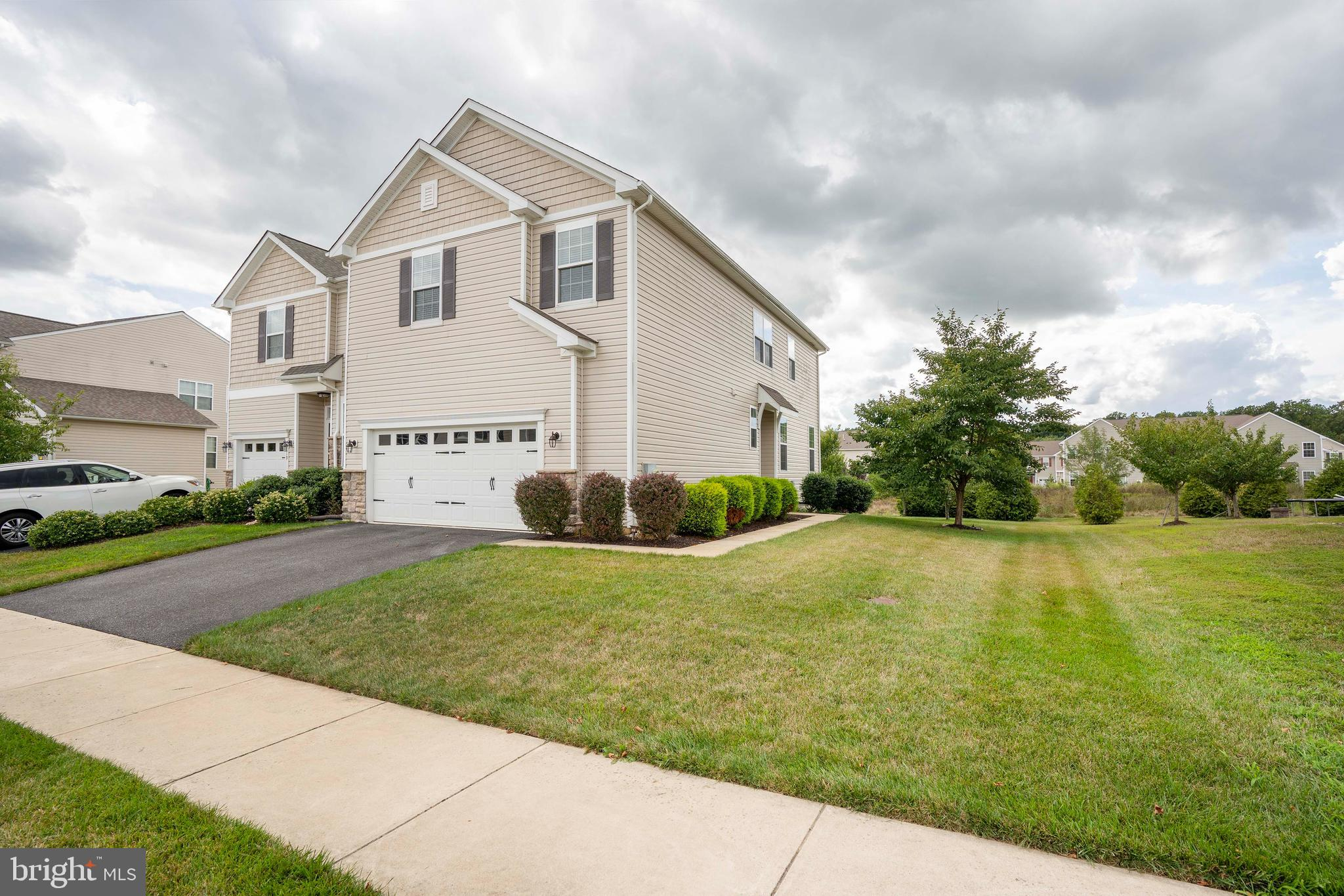Awaiting Signatures  **Highest and Best Offers Due 8/23 at 8pm** Welcome to 121 Margaretta Drive, located within the Desirable Community of Canal View! Conveniently Located Just off of Routes 1 and 13 with Easy Access to Shopping, Dining, and Parks - this home is a MUST SEE! Brand New Carpet & Fresh Paint Throughout Makes this Beautiful Abode Ready for it's New Owners! 3 Large Bedrooms, 2.5 Baths, a Finished Basement, and just about Every Option you can Imagine! Featuring a 2 Car Garage, Upstairs Loft that can be Converted to a Home Office, Gym or Playroom,  a Rough in for a Three Piece Bathroom in the Basement, a Maintenance Free Deck backing to Common Space where you'll be sure to catch deer frolicking quite often!  This Stunning Model has Room for Everyone and will Impress you with Every Turn! Schedule your Tour Today!