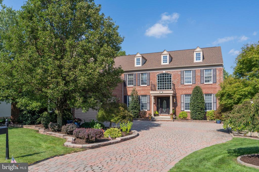 Welcome home to 10 Barn Owl Court in the prestigious Rivercrest Golf Course Community.  Located on a Cul-De-Sac street this  4/5 BDR, 3.5BA, 3 Car Garage is a must see.  The exterior features a full  brick front  with a brand new 30 year roof, new exterior paint, full hardscaped paver driveway, professional landscaping with lighting surrounding the entire home, sprinkler system and a koi pond.   Enter through the mahogany front door into the Dramatic Two Story Foyer with Wrought Iron Curved Staircase with gleaming hardwood floors.  The first floor features extensive finish moulding throughout, including double crown moulding and chair rail- A private office, formal living room, oversized dining room, two story family room and sunroom. The kitchen is a dream with upgraded cherry cabinets with custom inserts, walk in pantry, built in refrigerator, granite countertops, oversized island, new Miele dishwasher, and new flooring that carries into the sunroom. Step outside the sunroom for multi-level entertaining with a large deck with new decking material, and a large paver patio to enjoy private peaceful evenings.  The two story family room has a full floor to ceiling gas stone fireplace, with a wall of windows and a back staircase.  A private room  at the bottom of these steps could be used as a 5th bedroom or another private office.   Upstairs features a luxurious primary bedroom and bath, Two Walk-In Closets w/Custom B-Is, Sitting and Dressing Room.  Two secondary bedrooms share a Jack & Jill Bath and the fourth bedroom has it's own en suite bath.  The basement is ready to be finished and already framed! It also features a spectacular wood shop with shelving and a full walk out to your backyard.  This 3 zoned hvac home is also wired for a generator hook up.  Make your appointment today!