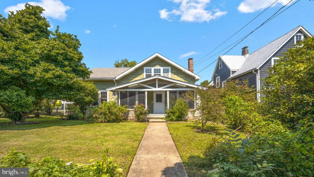Just listed in Brookland! This large 1922 bungalow is an absolute charmer. Set on a big corner lot, you are welcomed by a large, partially screened front porch with a beadboard ceiling and fan - perfect for watching the world go by. As you enter the large living room (you may or may not have twisted the vintage doorbell), notice the gorgeous original hardwoods, the molding and the wood burning fireplace. The formal dining room has built-in china cabinets, access to an enclosed side porch/mudroom with a gable window, and a passthrough to the kitchen. The kitchen features a farm sink, butcher block countertops and updated cabinets and backsplash. Behind the kitchen is a bedroom, a second mudroom with access to the backyard, and a full bath. An enclosed porch with built-in bookshelves would make a terrific study. An additional bedroom and a second full bath complete the main floor. Upstairs you'll find a kitchenette, a common area, two bedrooms, one flanked by huge eaves closets, and a full bath. The unfinished lower level has loads of potential with plenty of ceiling height and direct access to the backyard. Out back you'll find a large private yard with mature trees and vegetable beds. Truly a rare Brookland home.