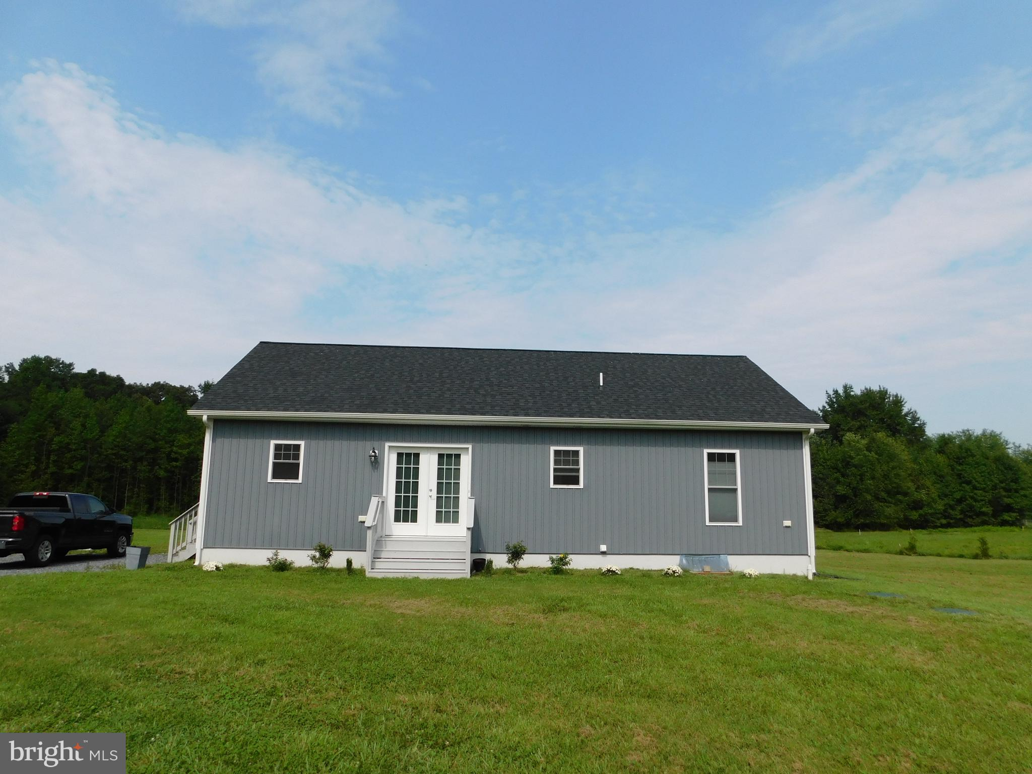 Almost New!  Amish stick-built in 2019, this beautiful 3 BR/2 BA ranch is on a huge piece of land!  Private 3.45 acres complete with your very own fishing pond.  Imagine having the space to play, fish and ride ATV's!  Camp in your own back yard.  The secluded custom ranch has a spacious open living area and the kitchen offers stainless steel appliances.  It also boasts a cement covered porch which overlooks a spectacular fall foliage display. Relax and enjoy your morning coffee while listening to the birds singing.  The home is energy efficient and virtually maintenance free with its upgraded board and batten siding and cost saving cellular shades. Located along the scenic Amish Bike Tour route, this home offers a unique opportunity to experience the good life!  Hurry, it won't last long.