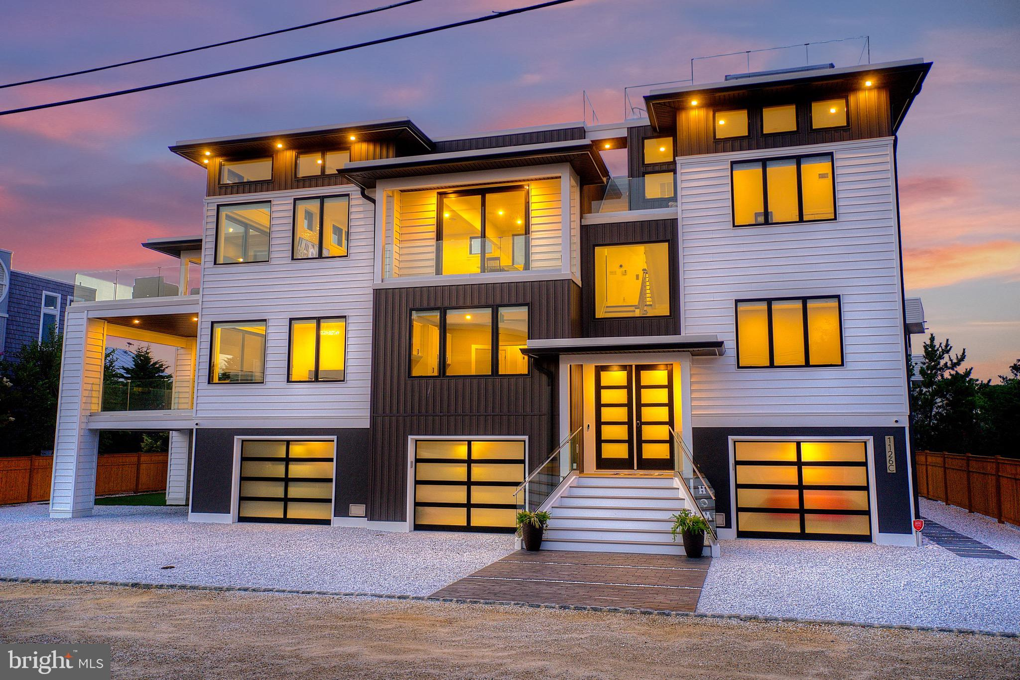 """*RARE FIND* Welcome to 1126-C Long Beach Boulevard! Some may say the """"C"""" stands for Custom. Nestled on a private lane in North Beach, this CUSTOM BUILT PREMIUM bay block home is just three homes to the bay and six homes to the pristine beaches of LBI. Perfect for year round living or a summer get away, this 2020 built home grasps panoramic bay views and partial ocean views. Enjoy beautiful sunsets and sunrises from almost any point of this gorgeous home, including the rooftop deck equipped with a built-in swim spa and illuminated custom glass railings. The three stop elevator makes reverse living a breeze. The first floor features three spacious bedrooms, two full bathrooms, a family room and a luxurious master suite equipped with bay views, a private balcony, a double walk in closet and master bathroom. The master bathroom features floor to ceiling custom tile, double frameless shower doors, double vessel sinks and in floor electric heat. The second floor showcases open concept living boasting 30x30 ceramic tile flooring, 12 foot ceilings with clerestory windows, a gourmet kitchen (with high end stainless steel appliances, dazzling Quartz countertops and tile backsplash,) a fifth sizable bedroom, a full bathroom, a dining room equipped with a wet bar (offering a second dishwasher and beverage fridge,) a living room featuring a cozy 60"""" Linear fireplace and 655 square feet of deck space. Other special features include power shade window treatments on the second floor, two tankless water heaters for maximum efficiency, a three car garage (with custom glass doors, accent lighting and epoxy floors inside,) a climate controlled gym on the ground level, 1,500 square feet of total useable deck space, a sound system throughout, a whole house Kohler natural gas generator, a turf side yard, recessed lighting, double outdoor showers and deeded Ocean access. Come enjoy all Long Beach Island has to offer at your very own Jersey Shore oasis."""