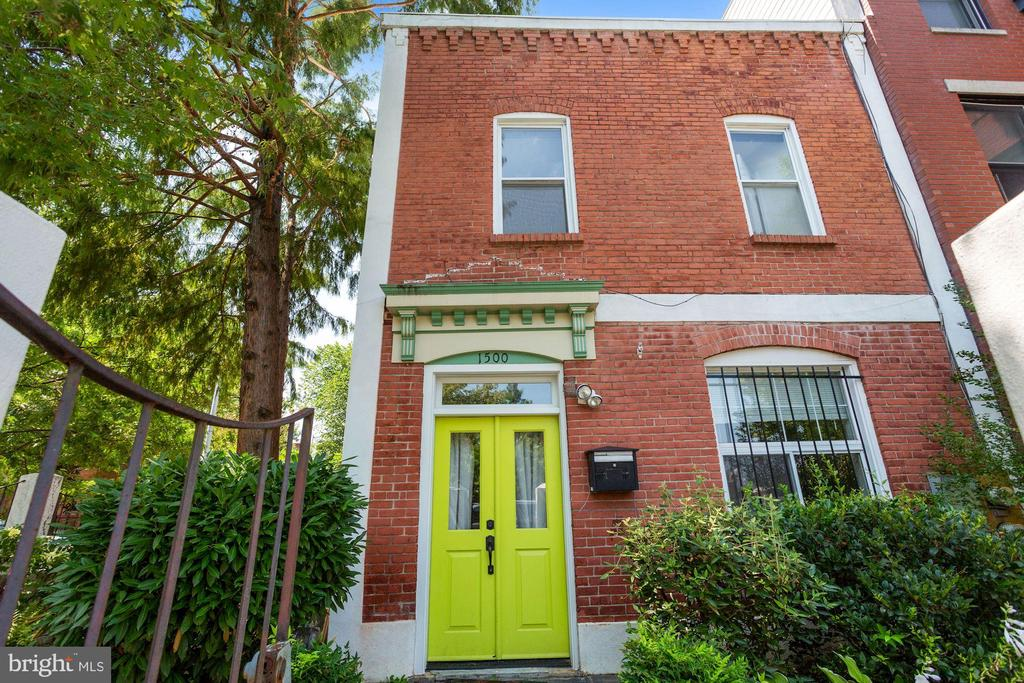 Please see virtual tour for 3D  tour.  Welcome home to this phenomenal end-of-row home situated in the heart of Logan at the corner of 10th and P Streets NW.  Presently configured as a duplex with income-producing in-law suite ($31,800/year), this prime location and yard would make for a lovely and spacious single family home spanning both levels.  Rich with history, the property boasts 2,000 square feet of finished living space.  It's quintessential corner lot provides an expansive side and front yard enclosed by a beautiful and unique iron and stucco fence.  While the current long-term tenant leases the ground-floor residence at $2,650/month, a new owner-occupant might consider converting one of the residences to a short-term rental that has the potential to generate $4,500-$6,000/month ($150 to $200/night) nearly covering one's carrying costs completely at today's low interest rates.    Each residence features two bedrooms and two baths, a full kitchen, independent HVAC system, hot water tank, and laundry machines.  The ground level unit enjoys the wrap-around garden while the second floor has a large private deck.    The truly amazing location offers quiet residential living amidst several exciting commercial districts including Logan, Shaw, downtown, and U Street.  Enjoy ease-of-access to metrorail, choice of grocery stores (Giant and Whole Foods), Logan Circle, and countless restaurants, bars, retail, entertainment, and more.