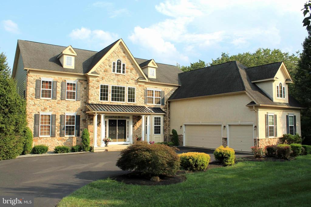 Gorgeous house with unique floor plan, situated in the Sanatoga Section of the Western Montgomery County, part of Raven's Claw Subdivision hence no HOA. Great location, minutes to Rt. 422 interchange, and Philadelphia Premium Outlet, short drive King Of Prussia.  This unique floor plan includes 4 BR all with attached bathroom. Over 5000 sf double door main entrance welcoming grand two story hardwood foyer with double front staircase, formal living and dining rooms chair rail and crown moldings. Two story Family room with gas fireplace, plenty of windows for natural lights and rear third staircase A large office room compliment with a dry bar area and half bath. Extra-large Gourmet Kitchen with break fast area , work station and exit to Deck, Island gas cooktop with downdraft exhaust fan, double oven, all stainless steel appliances and corian countertop. Mud room with outside exist and Laundry room complete the main level. Upper level consists of huge master bed room suite features a sitting area, 4 walk in closets, dressing area with vanity and master bath with whirlpool bath, his and her vanities and a large tiles shower, three other good sized bed rooms with attached bath rooms and upper landing complete the upper floor. Lower level full walk out basement, water proofed 9 ft high with a finished game room. 3/4 of the basement is available to be finished. Walk out exist to the back yard, sit under the deck and enjoy the privacy and tranquility. Backyard extents to a picnic area where you can enjoy a cookout listening to the babbling sound of the rain creek. A three-car oversized garage with extra-large driveway for 8 or more cars. All house sprinkler system is a plus and all sit in an acre of land.