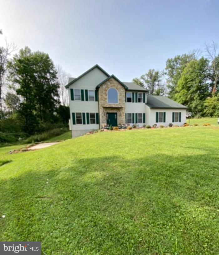 Huge 5+ bedroom on the edge of Exeter Township tucked away on 2 Acres overlooking the Oley Valley. Hardwood and tile flooring. Two fireplaces and upscale amenities. Slate tile patios, firepit and landscaping.  Lower level has a separate entrance, living room, dining room, bar, bedroom, bath, media room and private patio. Hi efficiency home  on acreage with all appliances remaining. Current legal address is 10 Santa Maria Rd Reading, PA 19606 as indicated in public records but there was a minor subdivision splittling off acreage from this property.  Upon transfer with new Buyer, the address will be changed to 1010 Fabers Rd, Reading, PA 19606 in Public Records.