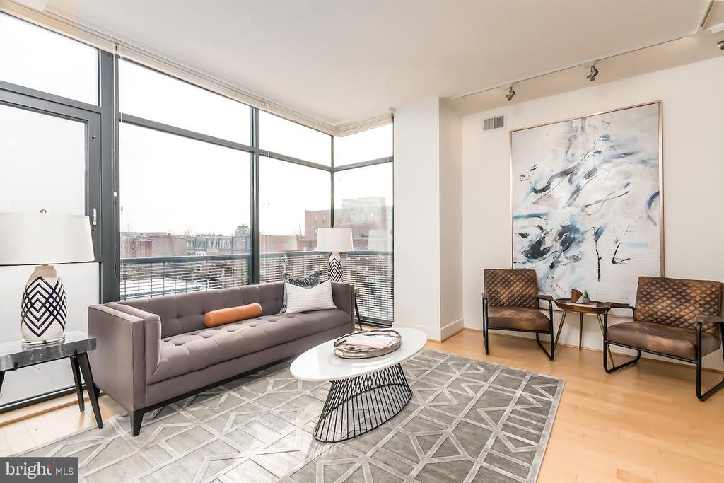 Luxurious Condominium in The Heart of Logan Circle | Building: Rooftop w/ Sweeping 14th Street Views, Boutique Building, 28 Residences, Elevator, Secure Garage Parking, Terraced Courtyard, Modern Lobby, Party Room | Unit: Hardwood Oak Flooring, Open Floor Plan, Expansive Floor-to-Ceiling South & East Facing Windows, Incredible 14th Street Views, Master Closet Built-in Closet System w/ Bamboo Shelving, Nest Thermostat, Efficient LED Recessed Lighting, Bosch Axxis Washer & Dryer | Kitchen: Porcelanosa Cabinets, Granite Countertops, Jenn-Air Oven, Gas Cooking, Sub-Zero Stainless Steel Refrigerator, Bosch Stainless Steel Dishwasher, Bosch Stainless Steel Over-range Microwave, Oversized Kindred Undermounted Sink, Grohe Faucet, Ample Storage, Generous Pantry, Eat-In Kitchen w/ Breakfast Bar, Pennant Lighting | Bath: Porcelanosa Tiling, Porcelanosa Floating Vanities w/ Storage, Custom Floating Shelving, Kohler fixtures, Kohler Toilets, Large Tub