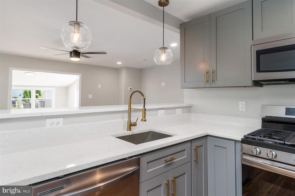 Beautifully renovated Cape Cod in the heart of Dundalk.  Wide open concept, kitchen leads into oversized family room, and run room in the rear.  The top floor has it's own private master suite, his and hers closets, a huge shower with bench.  2 more bedrooms and bath on the lower level.  Back yard includes 2 parking spots, and an additional third spot in detached garage.  Make your appointment today!