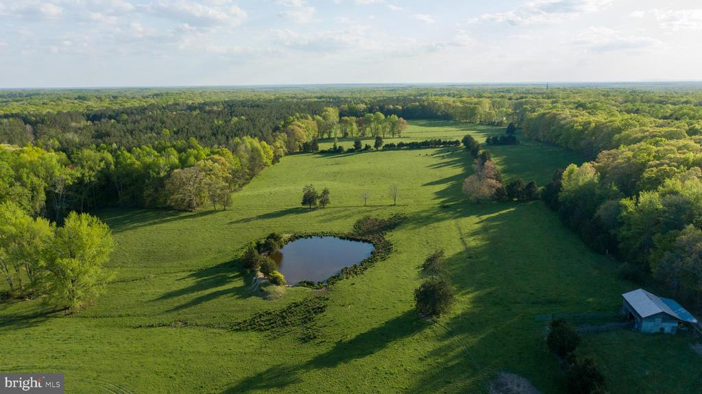 A combined 110 acres: 96 acres off Hartwood Road - TAX ID: 25-46 and 14 acres off Storck Rd - TAX ID: 25-34E. Property is made up of open pasture and 60 year old hardwoods located in the middle of the sought-after community of Hartwood. The property boasts gentle rolling topography, easy access from Hartwood Road and two ponds at the front and middle of the property. The property currently has several outbuildings on site with access from the established gravel driveway. The property is located just a short drive from Curtis Park. Currently leased and used as a farm, seller makes no warranty on old homes, buildings or utility on lot.