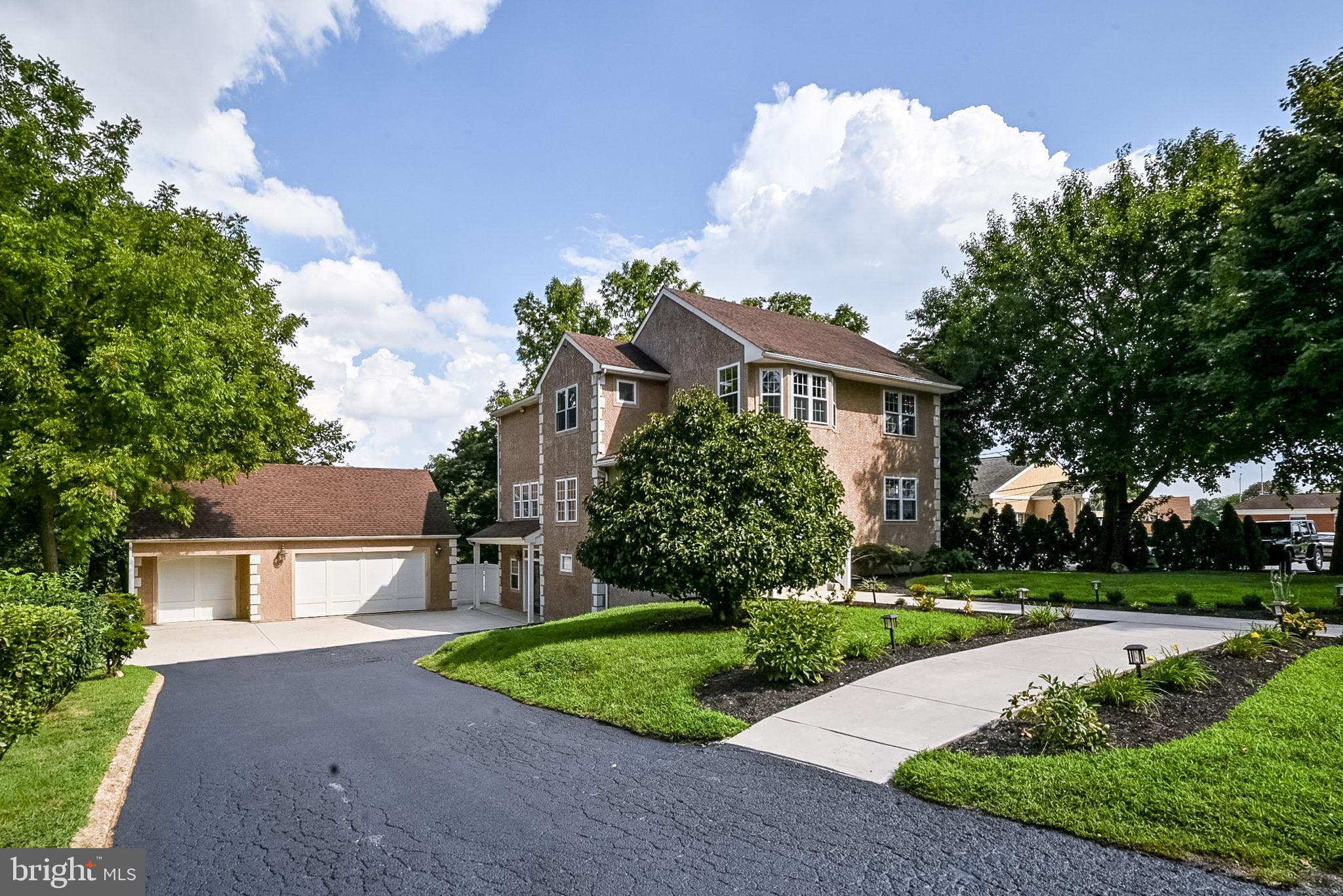 """SHOWINGS START ON SUNDAY 9/5/21.  Come tour this beautiful 3 level home built in 2004. The cathedral ceiling family room with french doors out to an oversized patio and view of Red Clay Creek will blow you away. The master bedroom also features high ceilings and french doors out to a large balcony, also looking over the creek. His & Her closets, an electric fireplace, and large bathroom complete the master suite. The shower is oversized with tile surround and seating inside, the Jacuzzi tub has extra jets, stall toilet provides privacy and the dual vanities make it easy for his and her. Two other bedrooms, a common bathroom and upstairs laundry are also on the upper level. The main level has an open floor plan with another bedroom (or office) and full bathroom. The kitchen is complete with granite counters, tile floors, tile backsplash, stainless appliances, 42"""" cabinets, double oven, double sink and island with built-in range. The house also features recessed lighting and wainscoting and chair rail moulding. Utilities have been updated with Dual zoned high-efficiency electric heaters with gas back-up, Tankless water heater, Radon mitigation system, and an in-house Dehumidifier system. The front is freshly landscaped, has updated walkways and parking for 9 cars in the detached 3-car garage. Easy access to Kirkwood Hwy. Schedule your tour today!"""