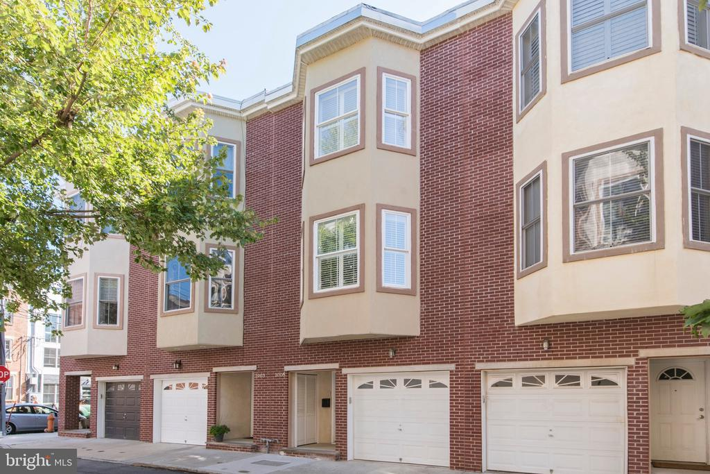 Welcome Home to 1005 Dorrance St. This spacious 3 Bedroom 3 and 1 half bath townhome in Graduate Hospital has it all; dark hardwood flooring, high ceilings,  recessed lighting, spacious rooms throughout, finished basement, garage parking, and multiple outdoor spaces caped off with a fantastic roof top deck thats view of the city is absolutely stunning! Enter through your extra wide garage-front to  the foyer past a full bath into the 1st floor bedroom/office with sliding glass doors to the outdoor entertaining space. Downstairs is a large finished basement perfect for an exercise room. Venture upstairs to the 2nd floor and kitchen that looks out to an open living and dining with plenty of light and balcony just outside the kitchen area. On the third floor past the 1st bedroom and hallway bath  is a laundry room and primary bedroom with en suite that has a stall shower and separate jetted tub.  If that all wasn't enough you must see the roof deck perfect for entertaining and sure to please!!!  You won't want to miss this gorgeous property with parking conveniently located by shopping, restaurants, parks, and all the city has to offer!