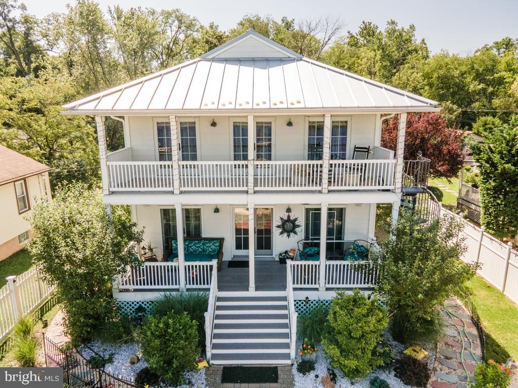 Showings do not start until Wednesday 9/8 @ 11AM  OPEN HOUSE This Sunday  from  11-2pm  Theres no place like paradise! Pull up your boat and dock your way in to your home off Rancocas Creek. Close proximity to Delaware River and easy access to all major Roadways, Route 130, 95, and easy accessibility to Philadelphia by car or  boat :)  Flood insurance is only $800 annually. Property has full riparian water rights. Beautiful open concept home perfect for hosting family & friend gatherings. Recessed lighting throughout. Possible elevator Shaft ( no mechanics installed current homeowners use as closet) ADA compliant bathrooms and handicapped level light switches.  Dual zoned heat system with heated & cooled flooring. Gas Fireplace,. Kitchen comes fully equipped with Walk in Pantry, Double stove, Eat in island bar. Bar Sink and Fridge for drinks. Gorgeous Master suite with stand up shower and vintage claw foot tub Walk in closet and enjoy your cup of coffee looking out to the water exiting the back deck with spiral staircase to access the backyard & river. 3 Generously sized bedrooms- 2 upstairs  and 1 downstairs perfect for an in law with access to the ada compliant bathroom.    Need room for all your water toys, motorcycles or vehicles? or personal guest house? Property comes equipped with full garage with access to the loft above the garage and full bath.