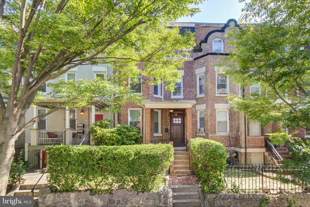 """Enjoy living in this Handsome, Spacious,  Brick Colonial Row House, perched on a tree-lined street in Park View, one  of DC's newest bustling neighborhoods.  It features Four(4) Levels, 6 bedrooms, 3.5 Baths,  with a fully finished  English Basement, rear and front entry, w/ 2nd Kitchen.  Main level includes an open floor plan with hardwoods throughout, fireplace, powder room exposed brick and high ceilings allowing  plenty natural light to flow through.   Gourmet kitchen  features gas cooking ,  granite countertops, recess lighting, and stainless steel appliances. Washer &  dryer on the upper and lower levels.  Off street parking.  Located between two Metros and sit steps  from the Greenline Metro Rail & Bus, cafes, restaurants and services that now occupy Park View's central location  as well as gourmet and convenience stores.  Commute made easy and accessible to Maryland, Virginia &  Airports.      SOLD """"AS IS""""  Zone (RF) Res Conversion Less than 5 Units.  Must See!!"""