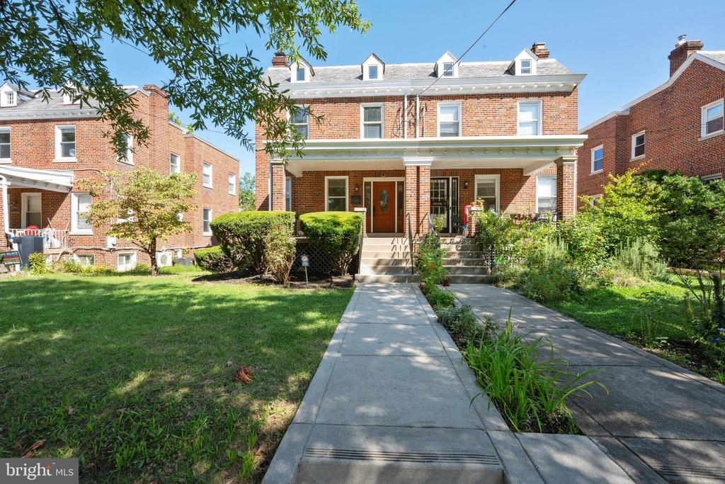 """Welcome to this porch front home that has been lovingly maintained by same family of 60 years, beautiful original woodwork, hardwood floors, wood burning fireplace, recent upgrades to kitchen, entire house freshly painted, large rear extension use as family room, office or what ever you desire. Lower level fully finished.  Rear parking, wonderful location. Property sold in """" AS IS"""" condition."""