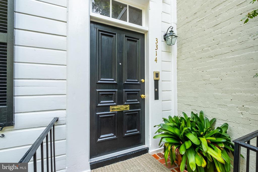 Rare offering in Georgetown's West Village! Exceptional prestigious & historic residence with total privacy and tranquil surroundings on a quiet one way cobblestone street. Large public rooms, 10' ceilings, 4 bedrooms, 4 1/2 baths,  31' living room, sunporches, office/ in law,/guest suite with bedroom & bath., pool, garage, All this within blocks of vibrant world class retailers, art galleries, restaurants as well as the Georgetown waterfront with parks, the Potomac River and the Capital Crescent Trail. Nearby is Rock Creek Parkway, Francis Scott Key Bridge and K street which provide quick and easy access to downtown, The White House, Kennedy Center, Washington's cultural monuments and both National and Dulles airports are convenient.