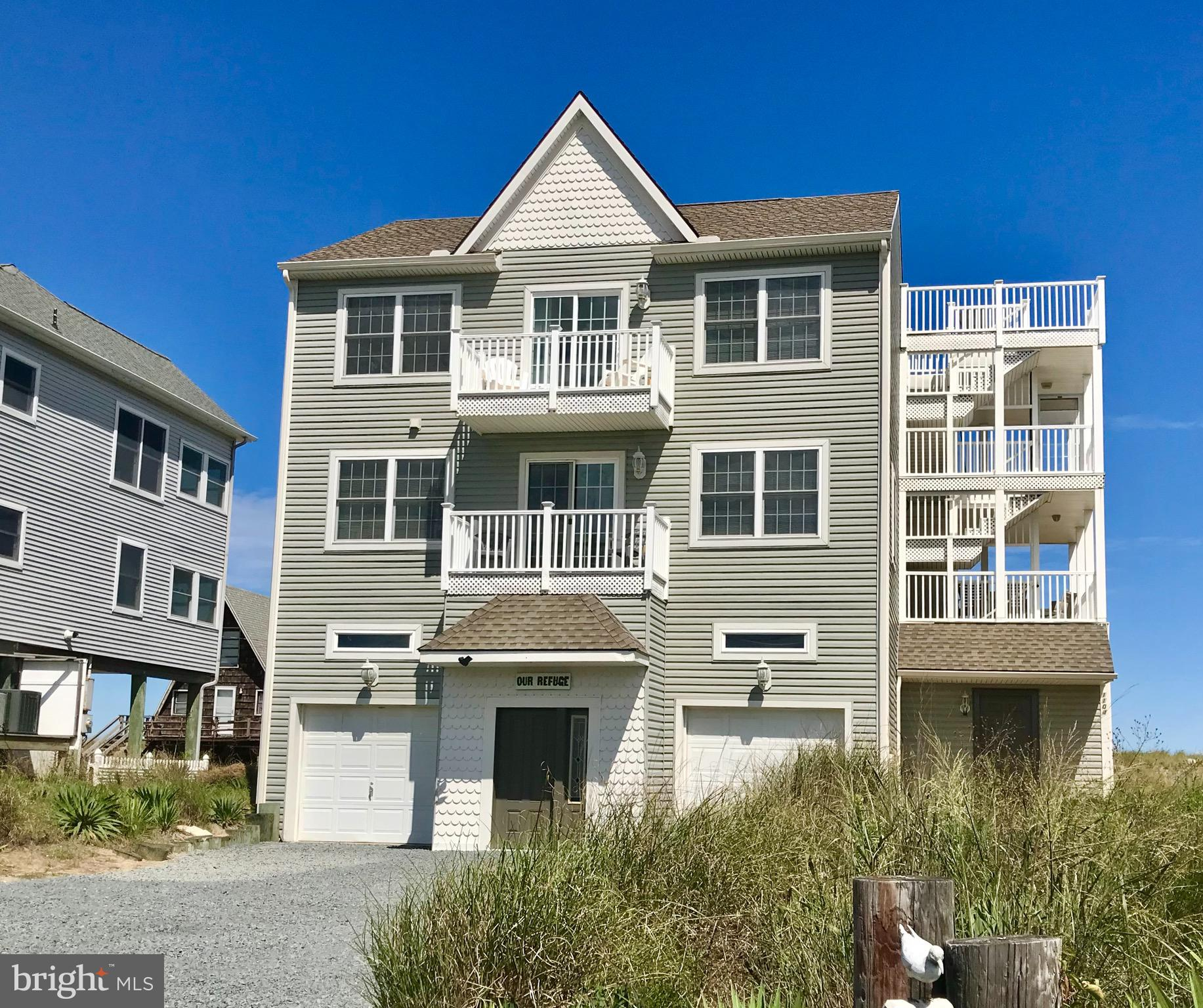 """Bright and Open Coastal Contemporary with  panoramic views of the Delaware Bay and Primehook Wildlife Refuge.  Rare Broadkill Beach Opportunity for a second home or proven lucrative vacation rental.  3BR 2 BA home with the flexibility of 2 owner suites and/or in-law suite.  Oversized 2 bay garage offering potential RV and/or boat storage with minimal modification.  Enjoy panoramic views of sunrises over the  Delaware Bay, Cape May, Lewes and stunning, unobstructed views of sunsets over the Prime Hook Wildlife Refuge.  Multiple decks surround the home and feature a fiberglass coating for years of low maintenance enjoyment.   The top deck level """"skydeck"""" will delight with its scenic vistas.  Just steps to the beach, this home offers endless outdoor enjoyment and activities. Just minutes from shopping, fine dining and entertainment in Lewes and Rehoboth Beach yet away from the traffic, crowds and headaches of no parking.  Home is move in-ready and sold furnished. Welcome Home!!"""