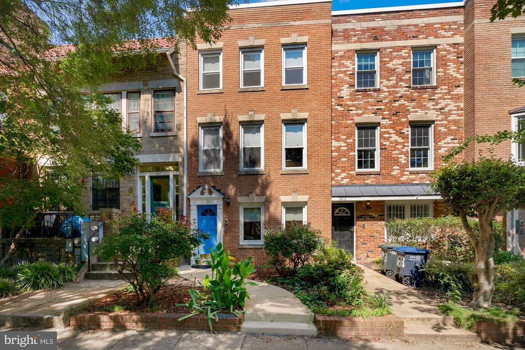 A warm and welcoming 2-unit townhome, conveniently located 1/2 mile from the Dupont Circle Metro and a short walk to countless restaurants and shops! ***The large 2-level 2 BR 1.5 BA upper unit features an open floor plan, hardwood floors, fireplace, quality architectural details, Anderson French doors to balcony, renovated kitchen, W/D, good storage. ***First floor 1BR 1BA apartment, separately metered for electricity, features parquet floors, fireplace, Anderson front windows, updated kitchen, W/D hook up, good storage, front and rear entrances, and a private patio. ***Large, fenced rear yard.  Sizable custom shed.  One parking space behind fence.  ***1/2 mile to Dupont Circle Metro, half block to Lauriol Plaza and a short walk to numerous other restaurants, nightlife, and shops in Dupont Circle, Adams Morgan, Logan Circle, and U Street corridor.   An incredible find!  Further detail: The large 2-level 2 BR 1.5 BA upper unit, with an open floor plan, is bright and inviting.  A step-down from dining room to living room defines the spaces.  Crown and chair rail molding and the wainscoting, are accentuated by soft, neutrally painted walls.  The living room includes a fireplace, and the recently refinished floors add to the feeling of newness.    ***Anderson French doors open to a small balcony.  A full side panel brings in even more light.  Stairs down lead to an unusually large patio, separated by tall shrubs from the smaller patio for the first floor apartment.  The sizeable, custom-built shed on the spacious patio is divided into a tool shed, a garden shed and a storage shed.  One parking space behind fence.  ***The renovated  kitchen features stainless appliances and quartz counters.  It is spacious, allowing room for a small table and chairs in front of the middle of three windows.  A large laundry/storage room is adjacent to the kitchen, and there is a first floor powder room.    ***The upper level has two generously proportioned bedrooms, each with good natura