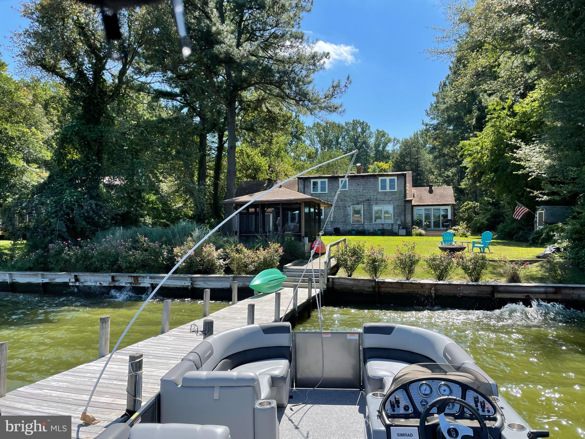 """PRICED TO SELL.  3BR, 2BA Waterfront Paradise.  Cardinals welcome you home to this Artist Cottage on 1 acre w deep water dock.  """"Cardinals Cove"""" has a high vantage point overlooking Herring Creek, migrating birds, kayakers & sailors.  Each day brings new beginnings, morning coffee, sunrises & checking your crab pots.  Friends & family will enjoy this cozy cottage.  Warm yourself on cooler evenings w your pellet stove.  Serenity & peace abound.  Be inspired to paint, journal, relax or venture on Herring Creek which offers access to Inland Bays to Lewes, Rehoboth, Dewey & Ocean via Indian River Inlet.  Bring your kayak, sailboat or pontoon.  NO HOA,  NO Restrictions & NOT in a flood zone. Full dry basement."""