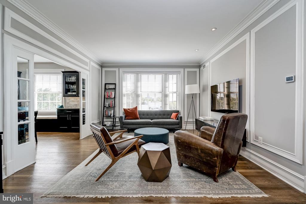 Prominently situated on the corner of 16th Street and S Streets NW, The Somerset House Condominium is an iconic Wardman building that was completely renovated beginning in 2014. Unit #512 is a high-floor 2 Bedroom and 2 Bath home that spans approximately 1,180 finished square feet. This special and sun-drenched unit showcases 3 exposures of natural light, including a stunning southern exposure with direct views of the Scottish Rite Temple, an eastern exposure with spectacular sunrises, and a tranquil northern exposure. This elegant home was renovated in 2015 and begins with a wide and welcoming Foyer that flows into a spacious Living Room. Off the Living Room is a generous corner Eat-in Kitchen that is complete with custom cabinetry, stainless steel appliances, marble counters and backsplash, and an oversized center island. With plenty of space to entertain, the live-in Kitchen is an incredible feature that has been thoughtfully designed with functionality and durability in mind. The Primary Bedroom is comprised of an En-Suite Bath and large closets. With breathtaking views of the Scottish Rite Temple, it is quite the opportunity to have such a historic DC landmark right outside your window. There is a second Bedroom and Full Bath, along with an in-unit Washer and Dryer. Pets are welcome.  The Somerset House Condominium provides a number of amenities including a contemporary lobby with a front desk, an exercise room, a wine/party room, bike storage, additional storage space for each individual unit, and a common laundry room. With a Walk Score of 98, this excellent location is centrally located near it all. 1801 16th St NW is 5 blocks to two Metro Stations, 6 blocks to the base of Meridian Hill Park, 2 Blocks to the 14th Street Corridor, and 6 Blocks to bustling K Street.